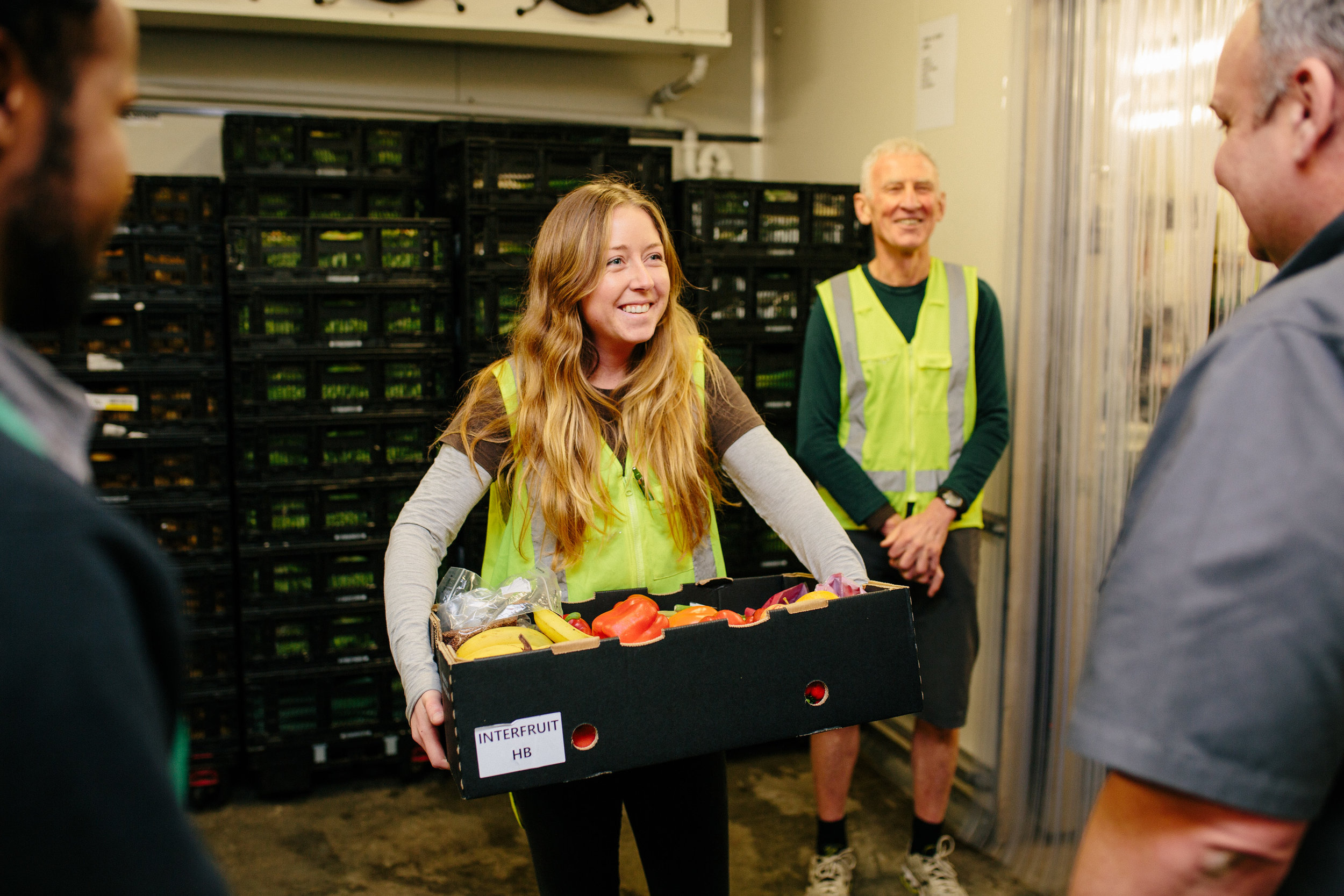 Kaibosh driver Dee Corcoran accepts a boxful of fruit and veggies from Countdown's Nigel Harman (right)
