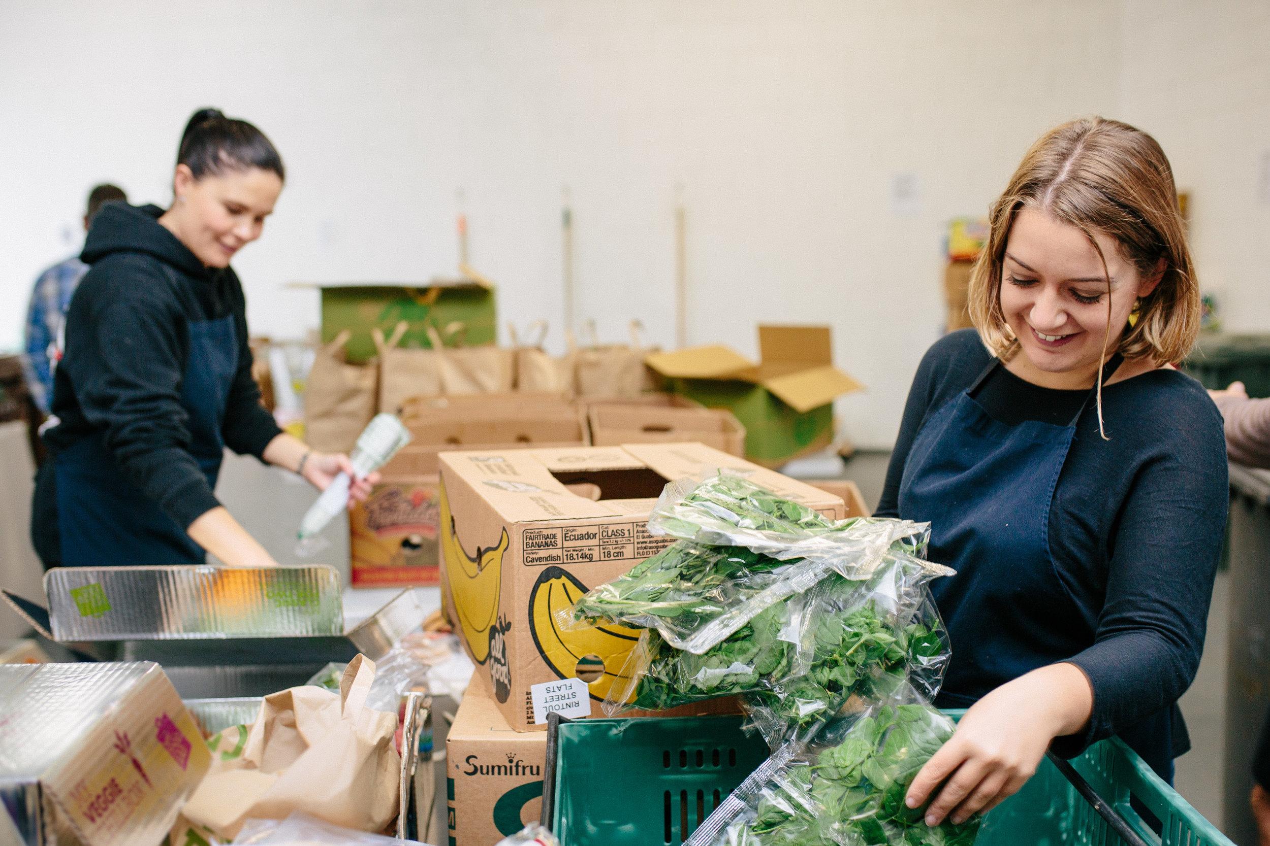 Kaibosh volunteers Hayley Osborne (left) and Natalie Verner get stuck into sorting