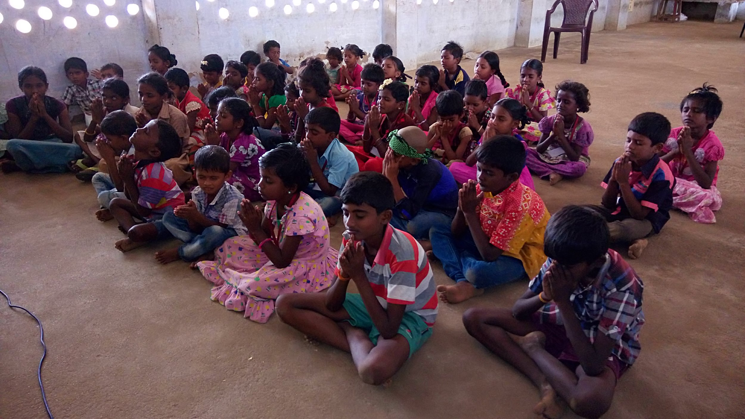 Leading the children in prayer.JPG