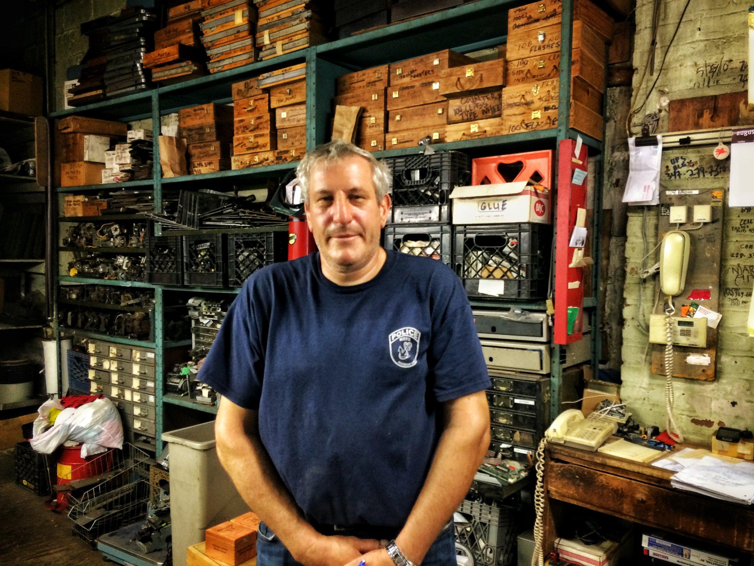 Brian Faerman in his store, Faerman Cash Register Co.  Photo credit P. Peterson