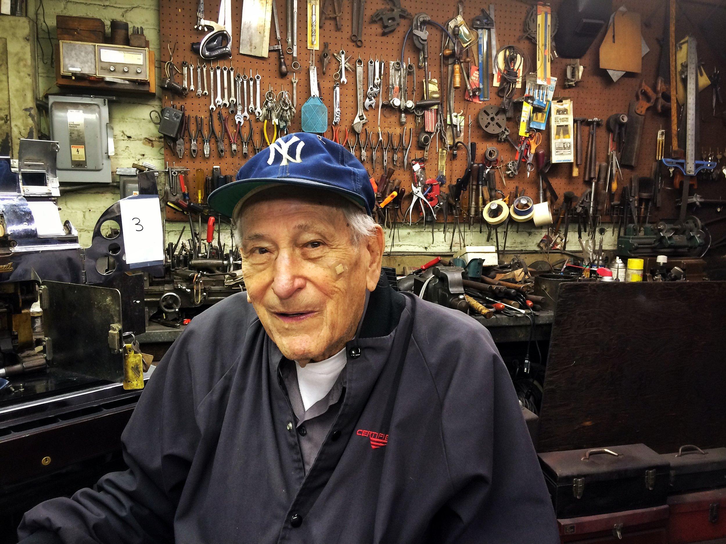 Bernard Faerman in his workshop in the back of Faerman Cash Register Co. Photo credit P. Peterson