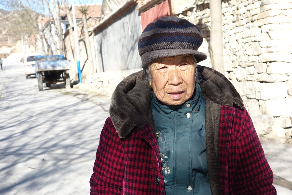 Zhao Ying, 77, was the first person I photographed in Zhenbiancheng. When I lifted my camera with an inquiring look, she just nodded and continued chatting to Liu. She was always friendly and welcoming in a no-fuss way.
