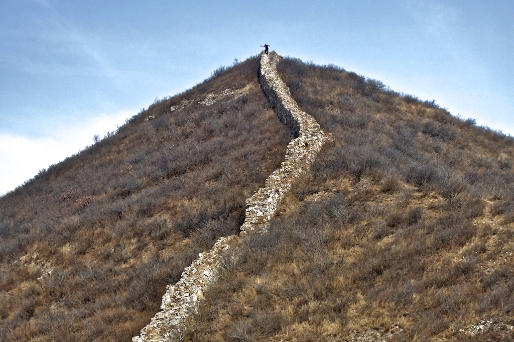 Roger was not pretending to surf the Great Wall. He was trying to keep his balance on the crumbling rocky surface on a cold and windy day.