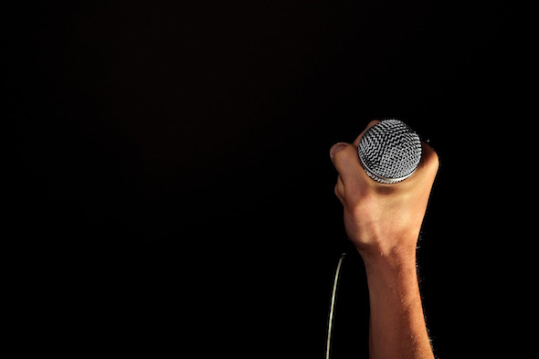 Hand holding microphone - accompanies article about how to make the most of a music PR campaign