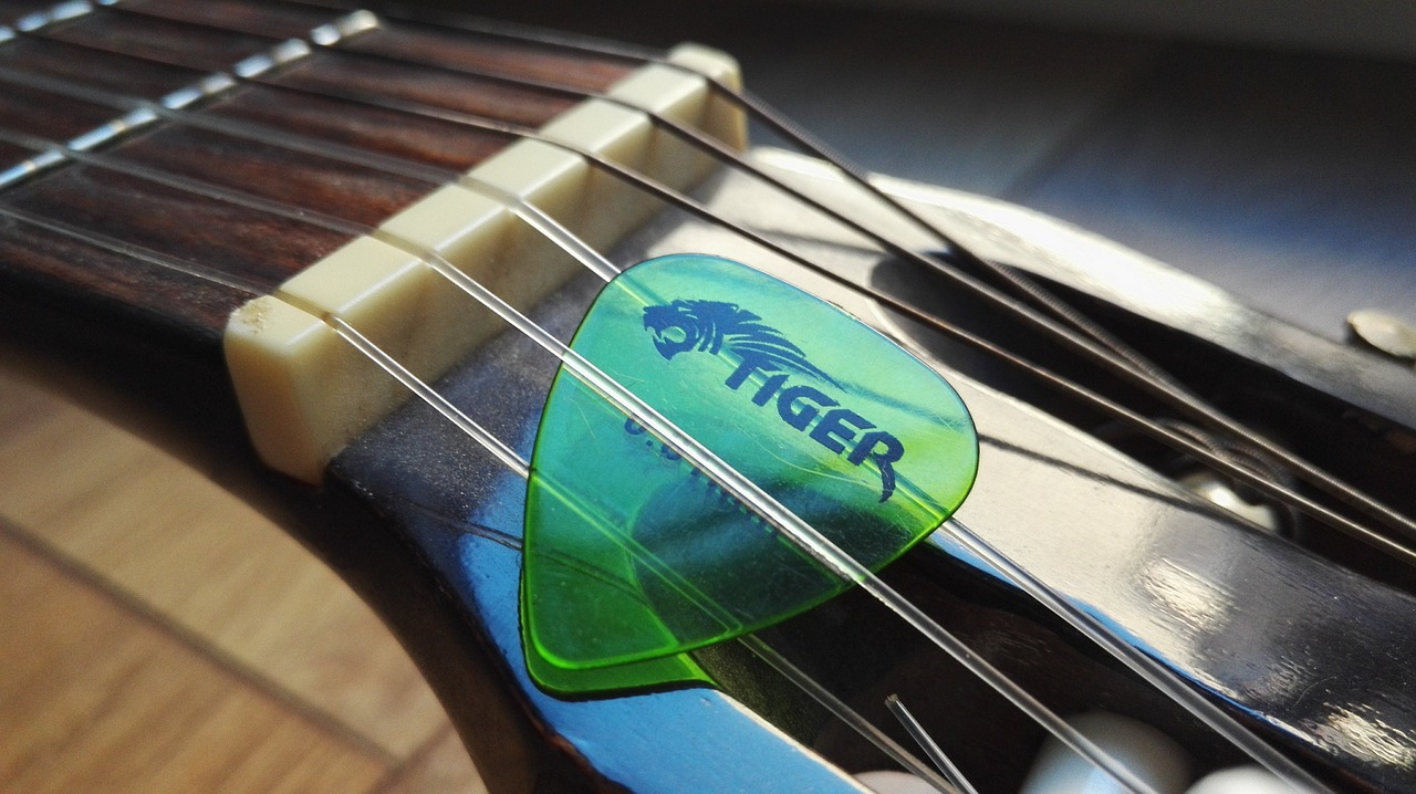 Plectrum and guitar - image accompanying an article about 'band hacks'