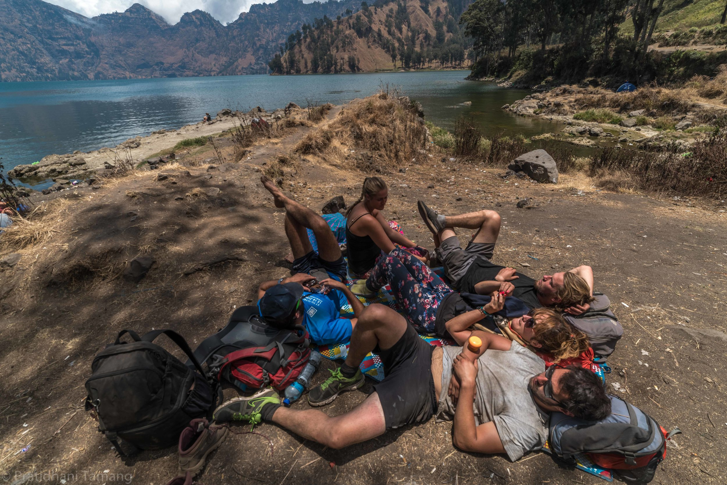 Crew resting before we went to hot a water pool/ spring. The water warmed up naturally because of the active volcano.