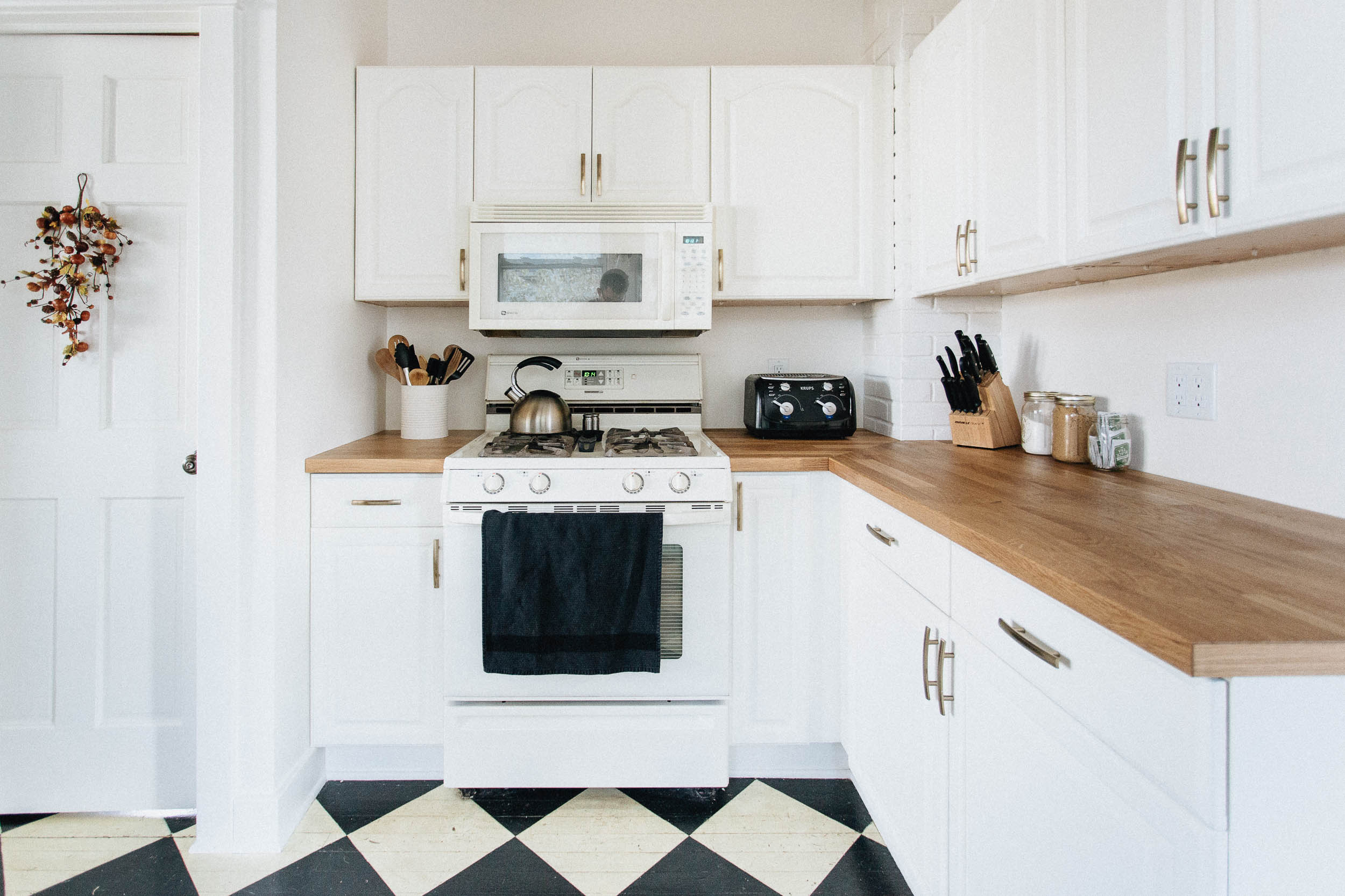 Bright White Kitchen with Butcher Block Counters