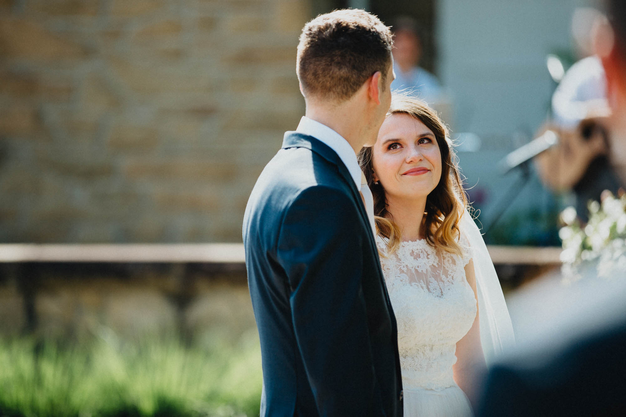 Bride Looks Lovingly At Her Groom During Their Ceremony