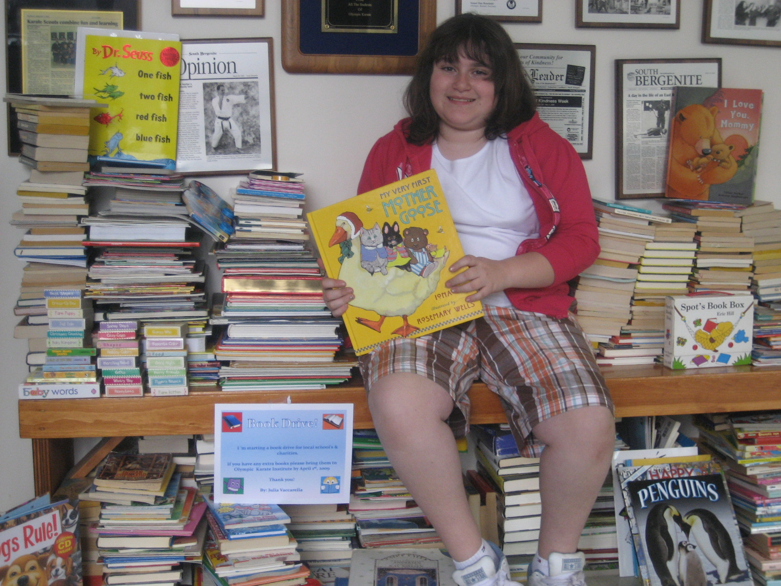 Julia Raises 1,000 Books for TheDOJO Book Drive and Starts a Library