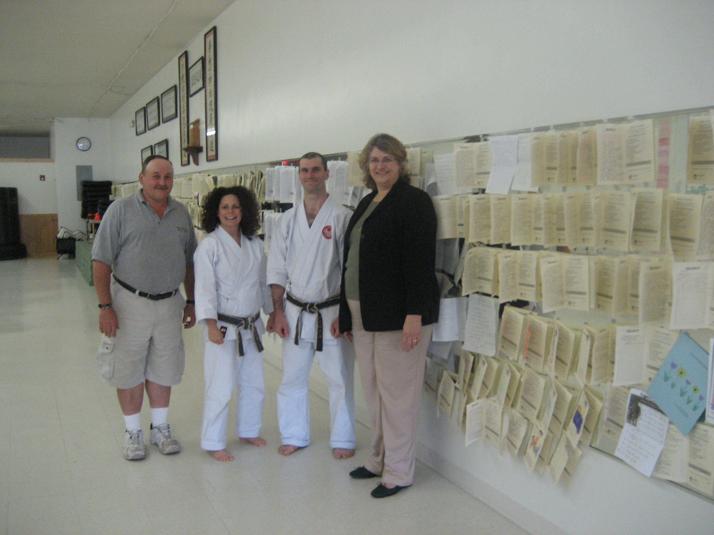 Members of the Rutherford Business improvement district and sensei dan rominski, wife kim christian with displayed Acts of Kindness journals 52,853 logged random acts of kindness.