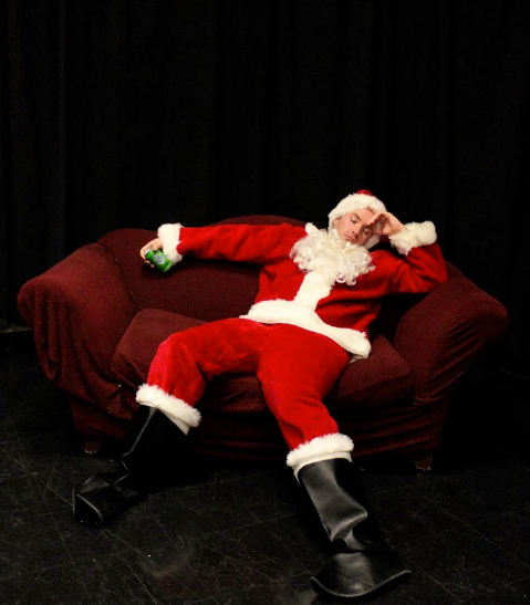 The only difference between Leslie and Saint Nick? They both bring as much joy to people, but Leslie is real. Photo courtesy of  Outtake Improv .