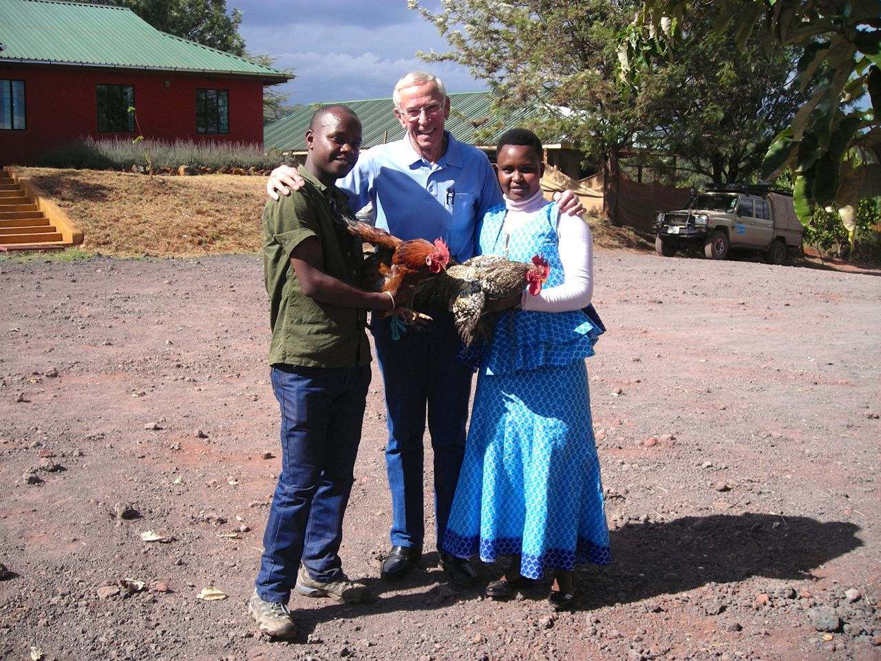 Martina and her husband gift Dr. Duane with two chickens