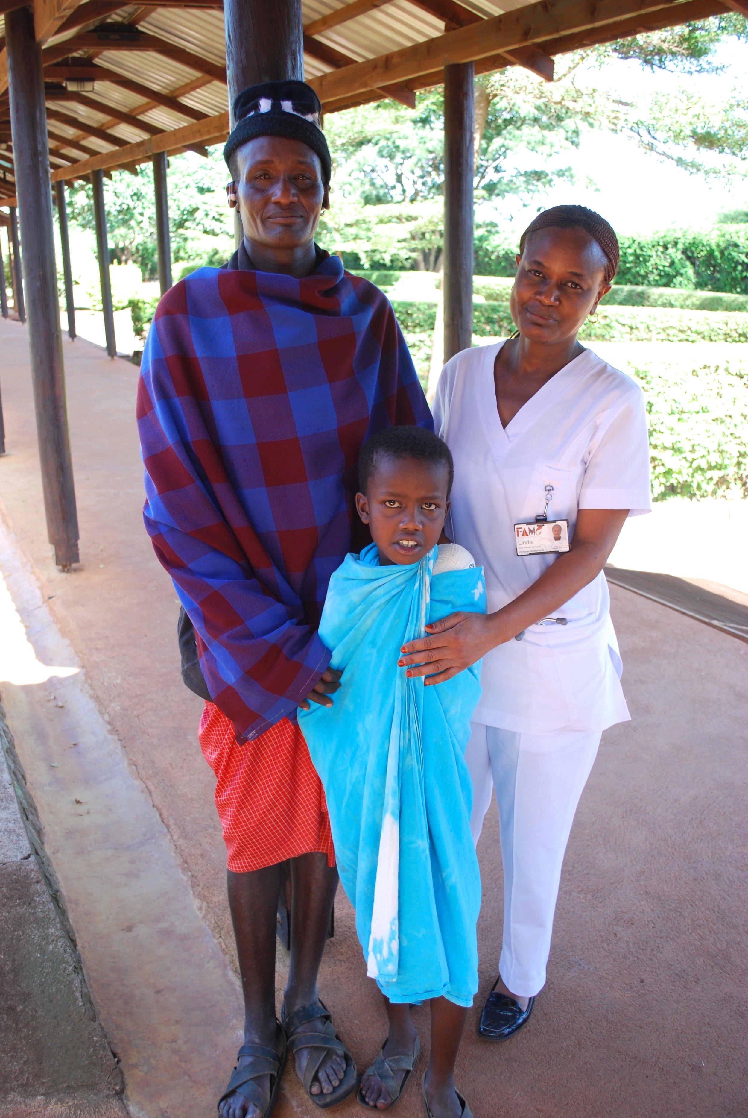 Lemayian, Linda, and Emmanuel after his operation