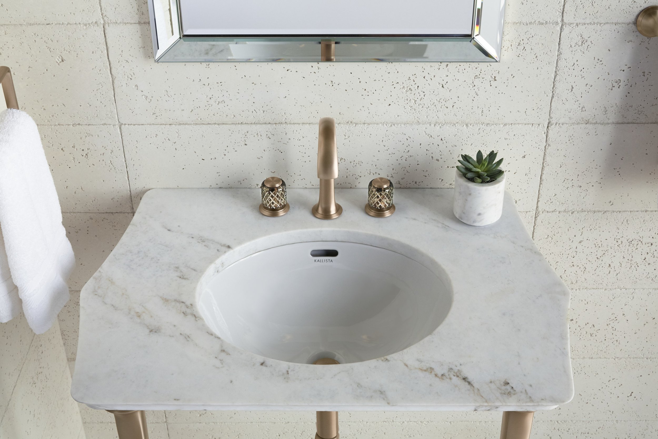 Script arch spout faucet in blush bronze (new finish) with St. Louis crystal knobs and Script console.jpg