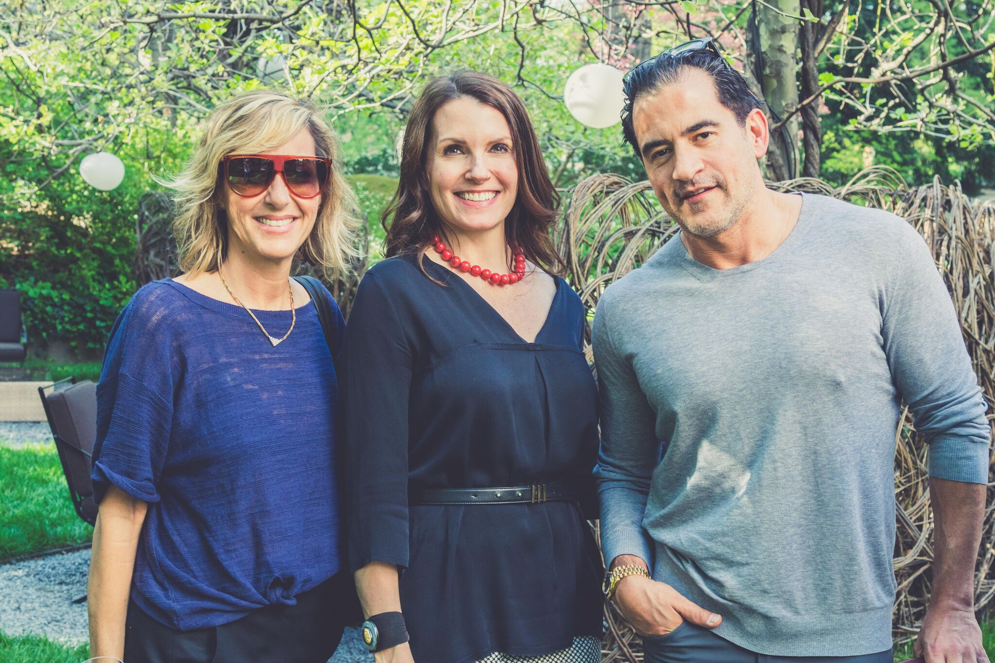 Ginna Christensen, Gina Dewitt and Rodrigo Vargas in the garden of the Bulgari Hotel