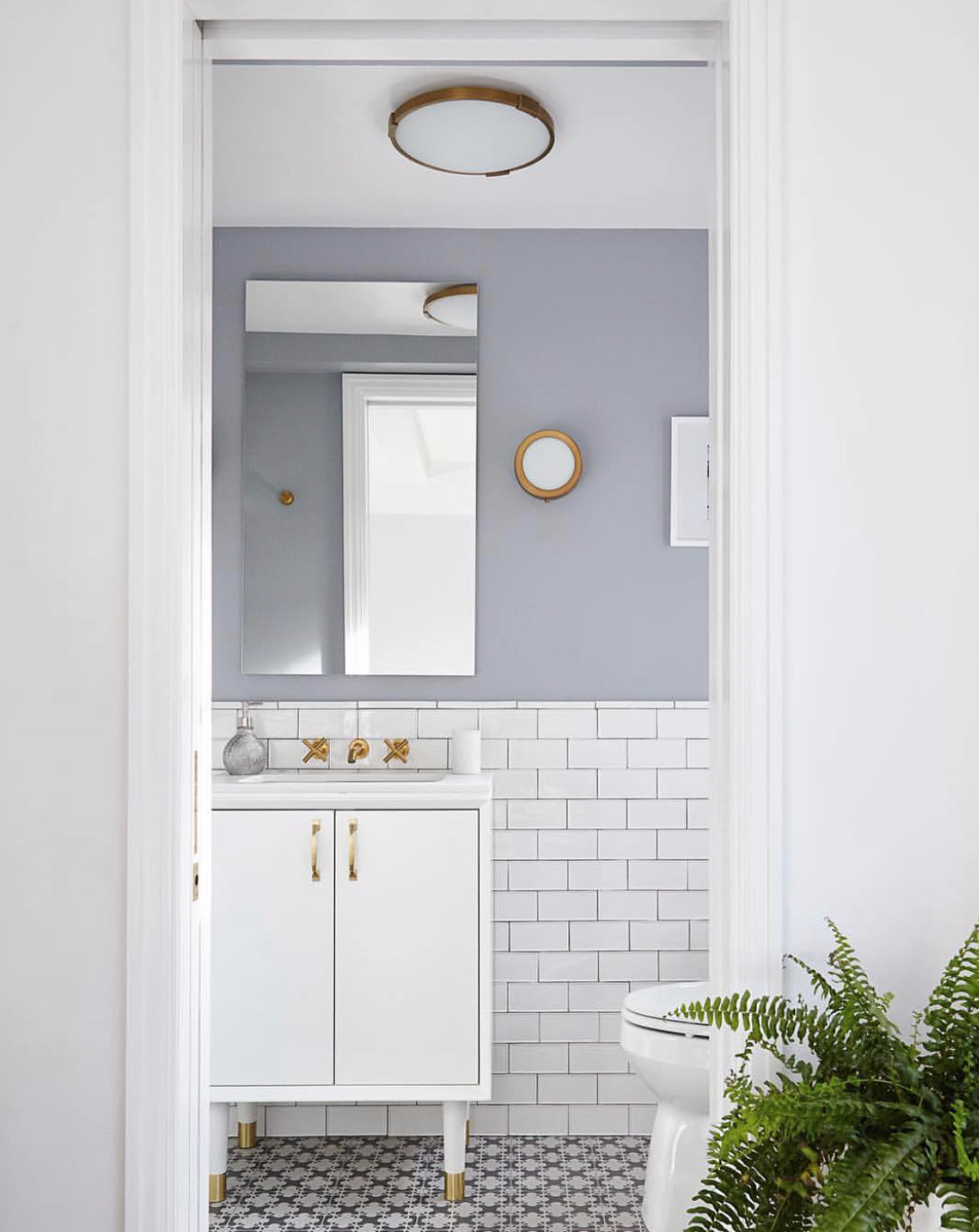 @lra_architecture  created a bright and airy powder room through the combination of sleek fixtures and a clean color palette.