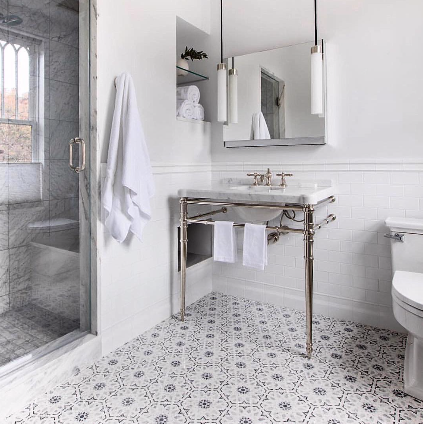 Traditional meets modern in this classic bath by  @reid_havenbuilders . The Uplift lighting and cabinetry is paired with the Inigo collection by  @kallistaplumbing .