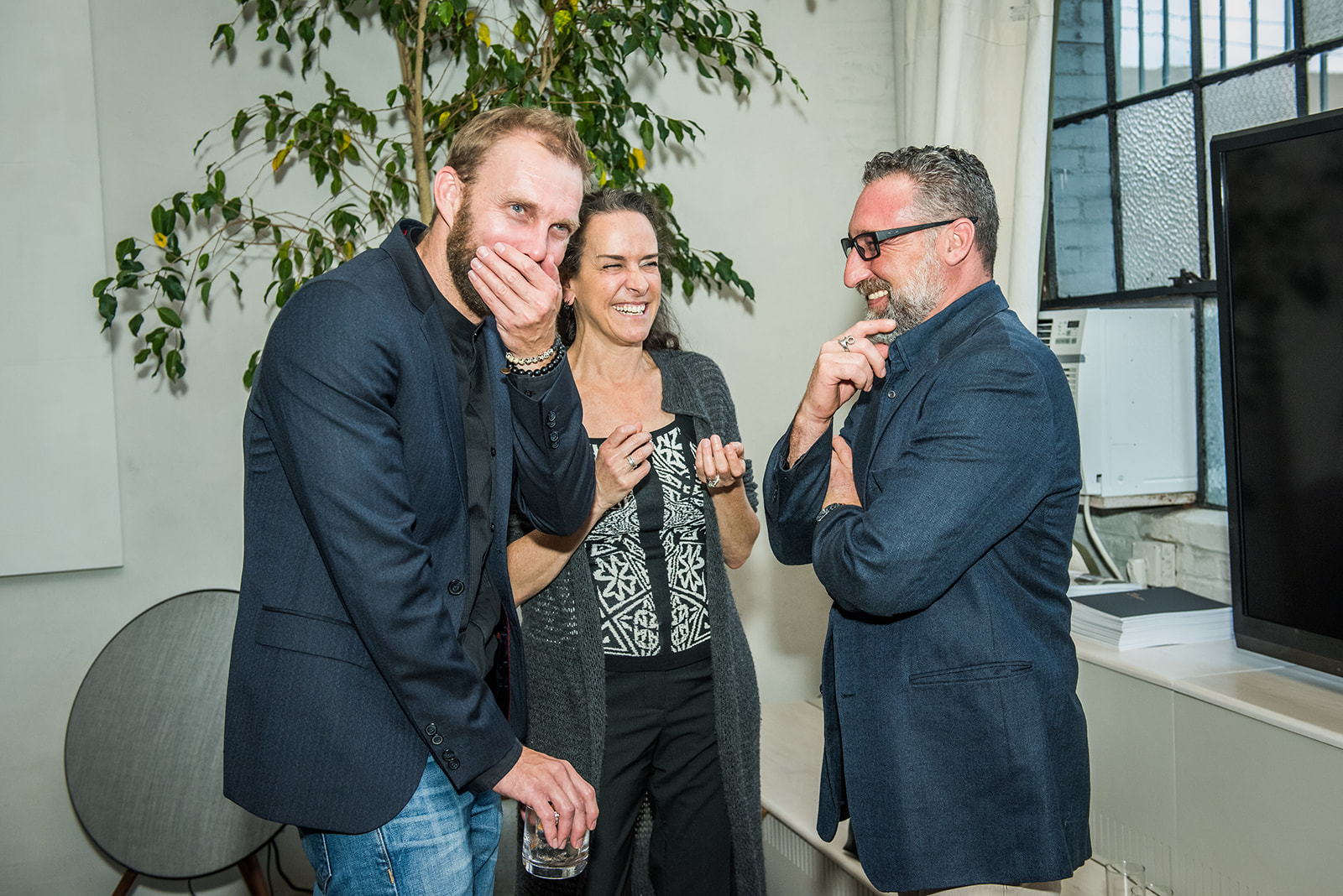 A good time was had by all! Christopher Courts, Joan Barton and Dan Turner share a suspiciously naughty laugh.