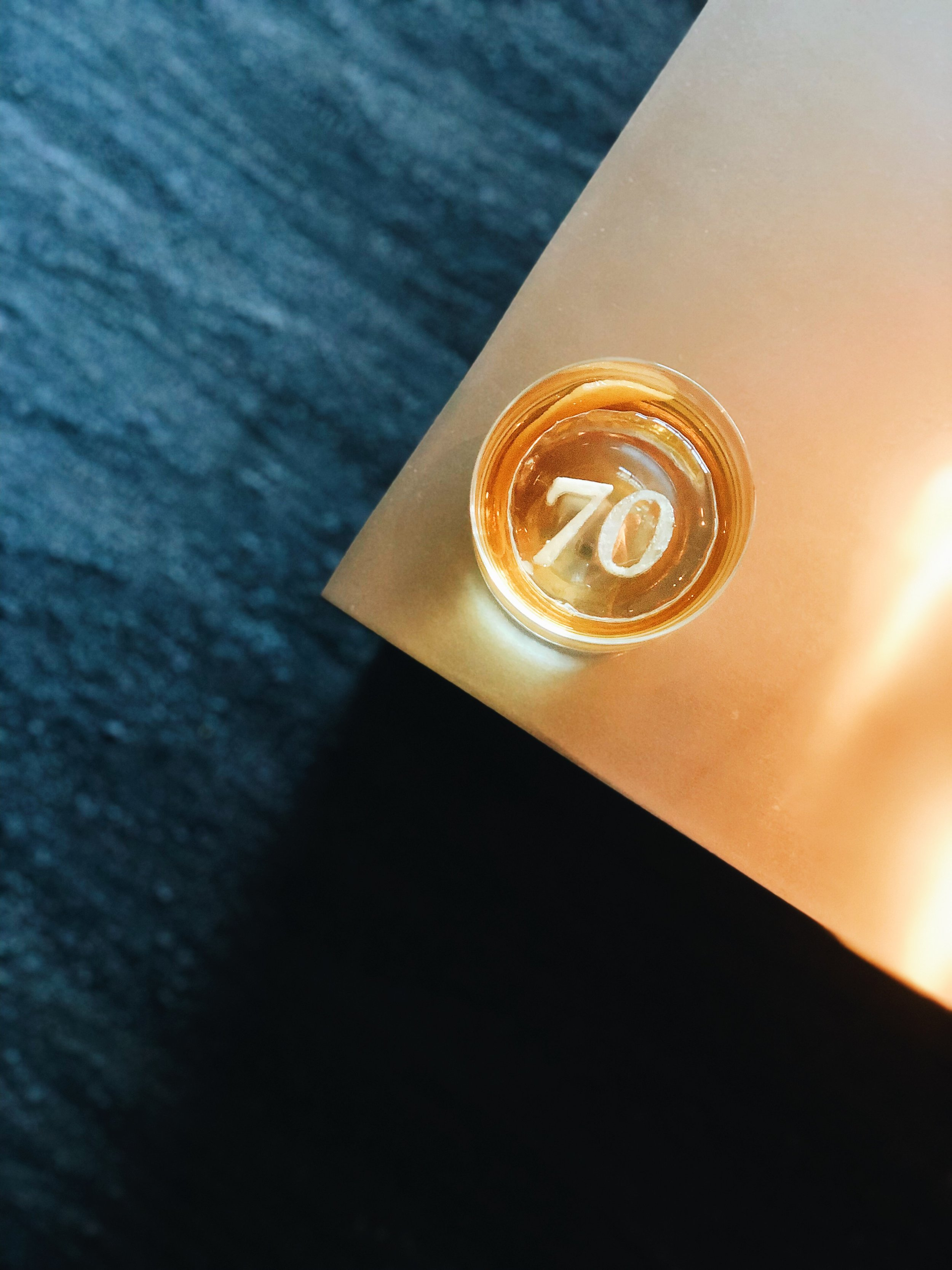 We love Erik Eastman's shot of the custom ice cubes he made with our 70th logo.