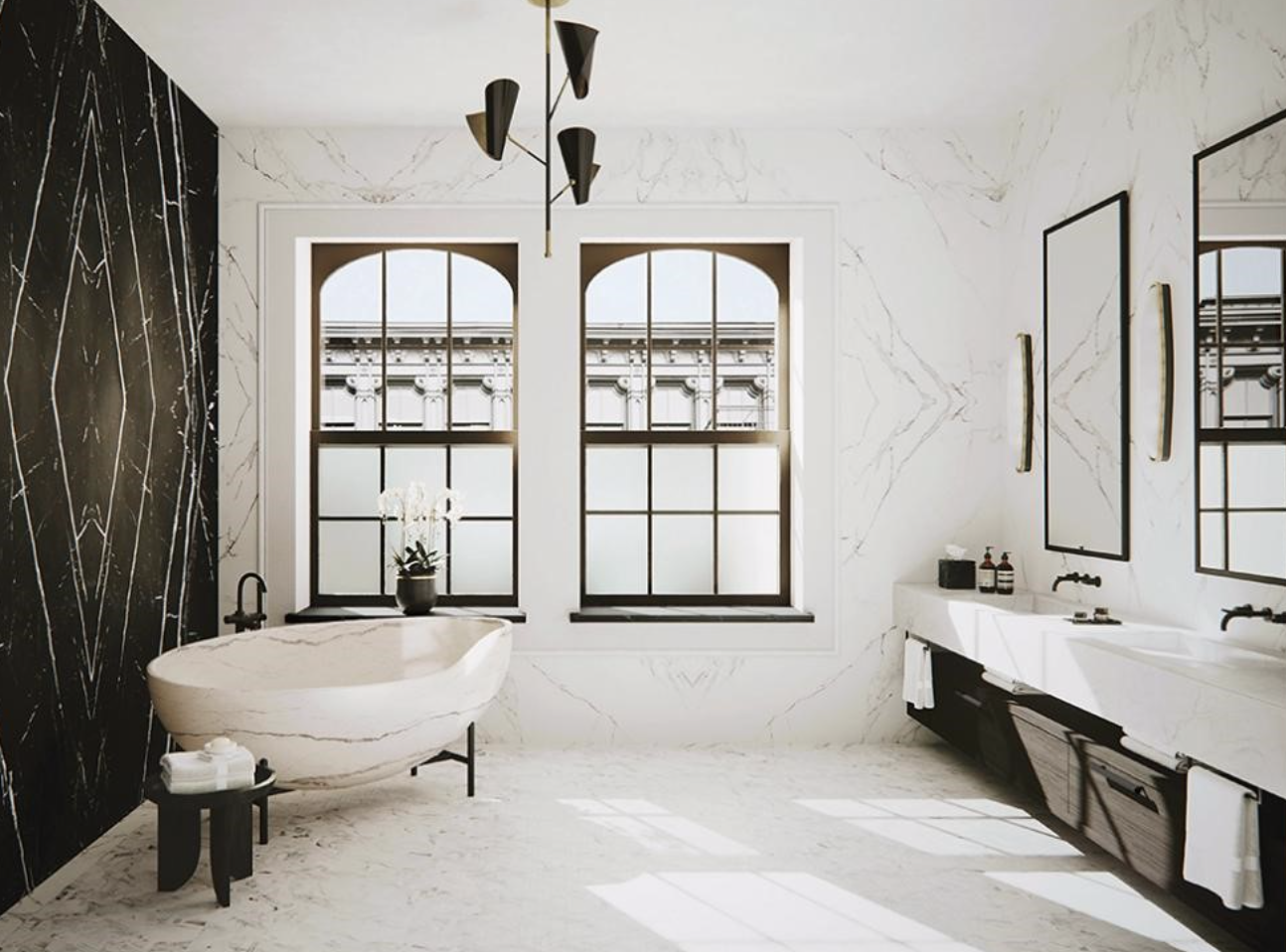 """Above: Designer  Dorothee Junkin of DJDS  recently chose Kora for a NYC loft project. """"In the master bathroom, a composition of book-matched white and black marble slabs creates a feature backdrop for a freestanding sculptural soaking tub carved from a solid block of marble,"""" she said. """"As in the primary spaces of the apartment, layered light finishes stand in deliberate juxtaposition to select dark feature elements that aide to imbue each space with the individuality it deserves"""""""