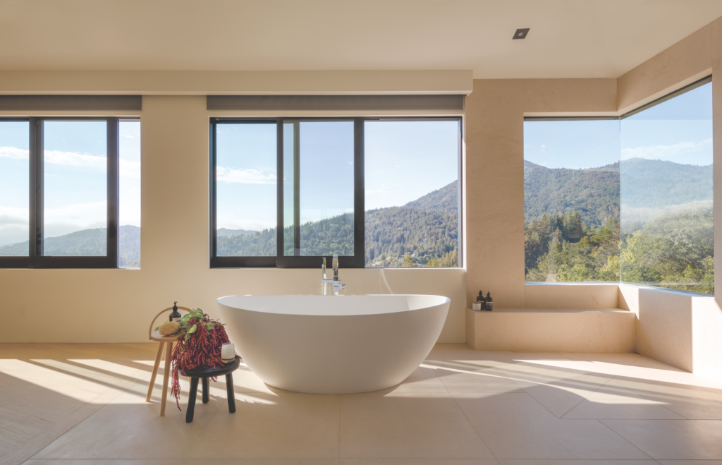 A soaking tub with Graff faucets provides a covetable vantage point. Photograph by  Eric Rorer