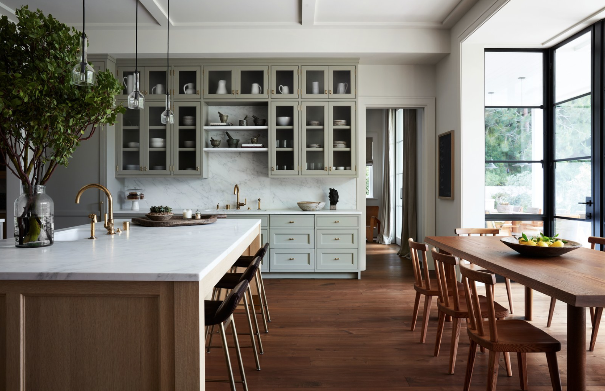 A stunning eat-in kitchen designed by architect  William Hefner  was featured on  Architectural Digest online . Photograph by  Stephen Kent Johnson