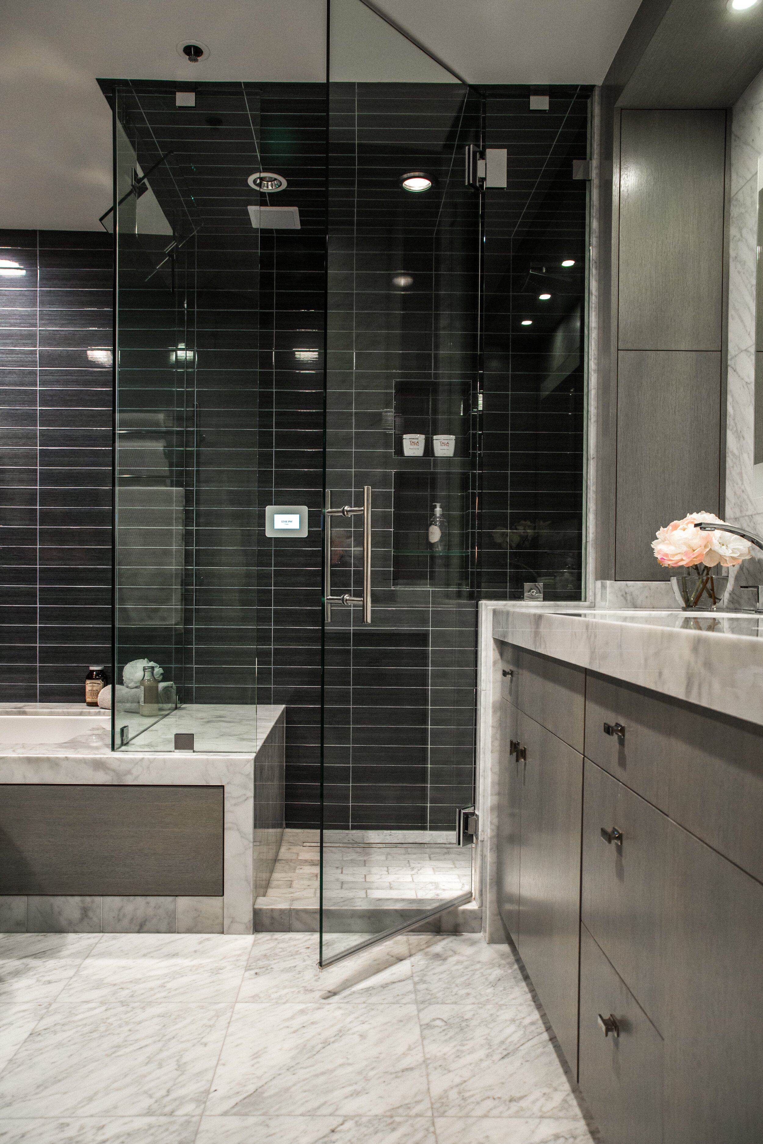 A West Hollywood condo bathroom designed by Lori with a Mr. Steam shower system. Photograph by  Bethany Nauert