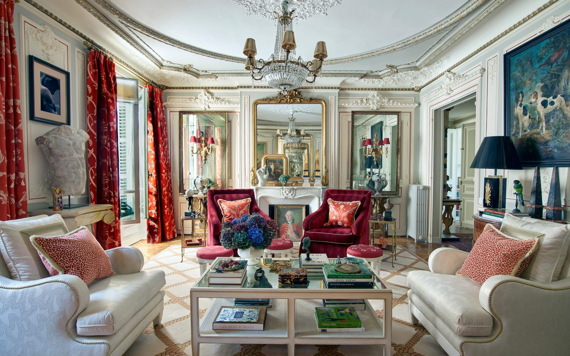 A room in Timothy Corrigan's new book by Rizzoli features a play of reflections with multiple mirrors. The seating and cocktail tables are from Corrigan's furniture collection for Schumacher, and the rug is one he designed for Patterson Flynn Martin. Photo: Richard Powers