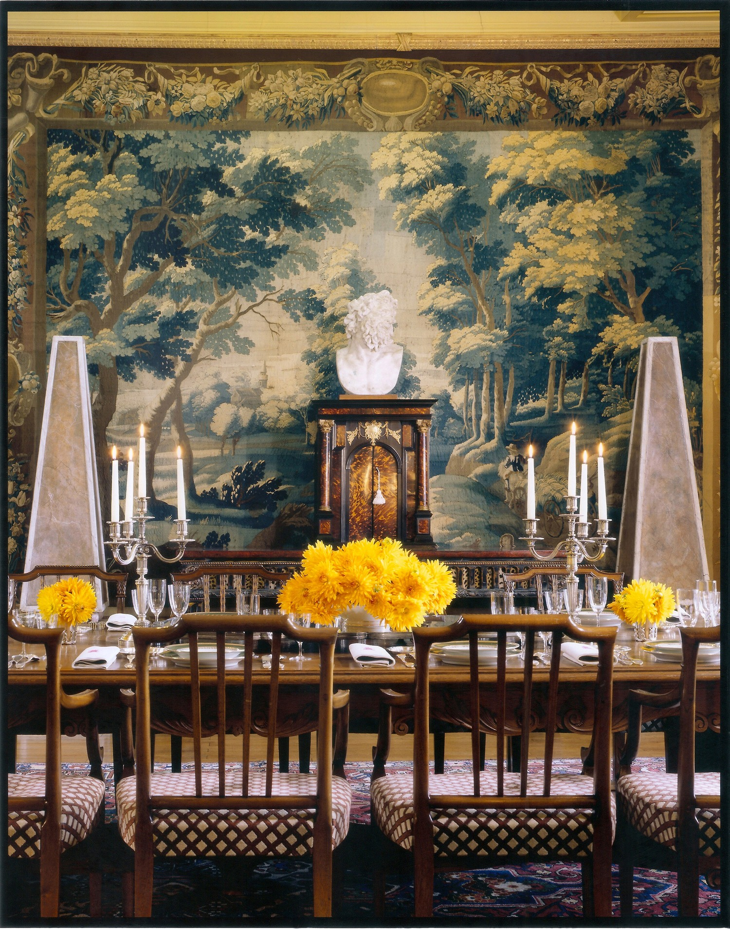 """""""In this dining room in France, I hung a 17th-century tapestry as a focal point. I love the depth and texture a tapestry brings to a room. I favor old ones for their faded colors and textures, but there are many beautiful modern tapestries as well, and they are often affordable."""" Photo: Marina Faust"""