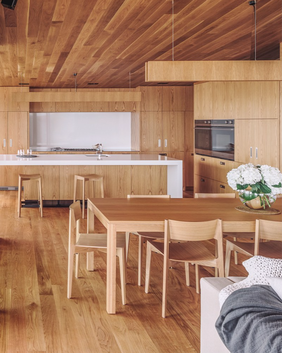 Created by Paul Clarke of  @studio2architects , the kitchen of this gorgeous holiday home is large and spacious, providing ample room for family cooking. Integrated Fisher & Paykel appliances hide behind the beautiful oak cabinetry to maintain a consistent aesthetic throughout the open plan kitchen and dining area. ?  @simon.c.wilson