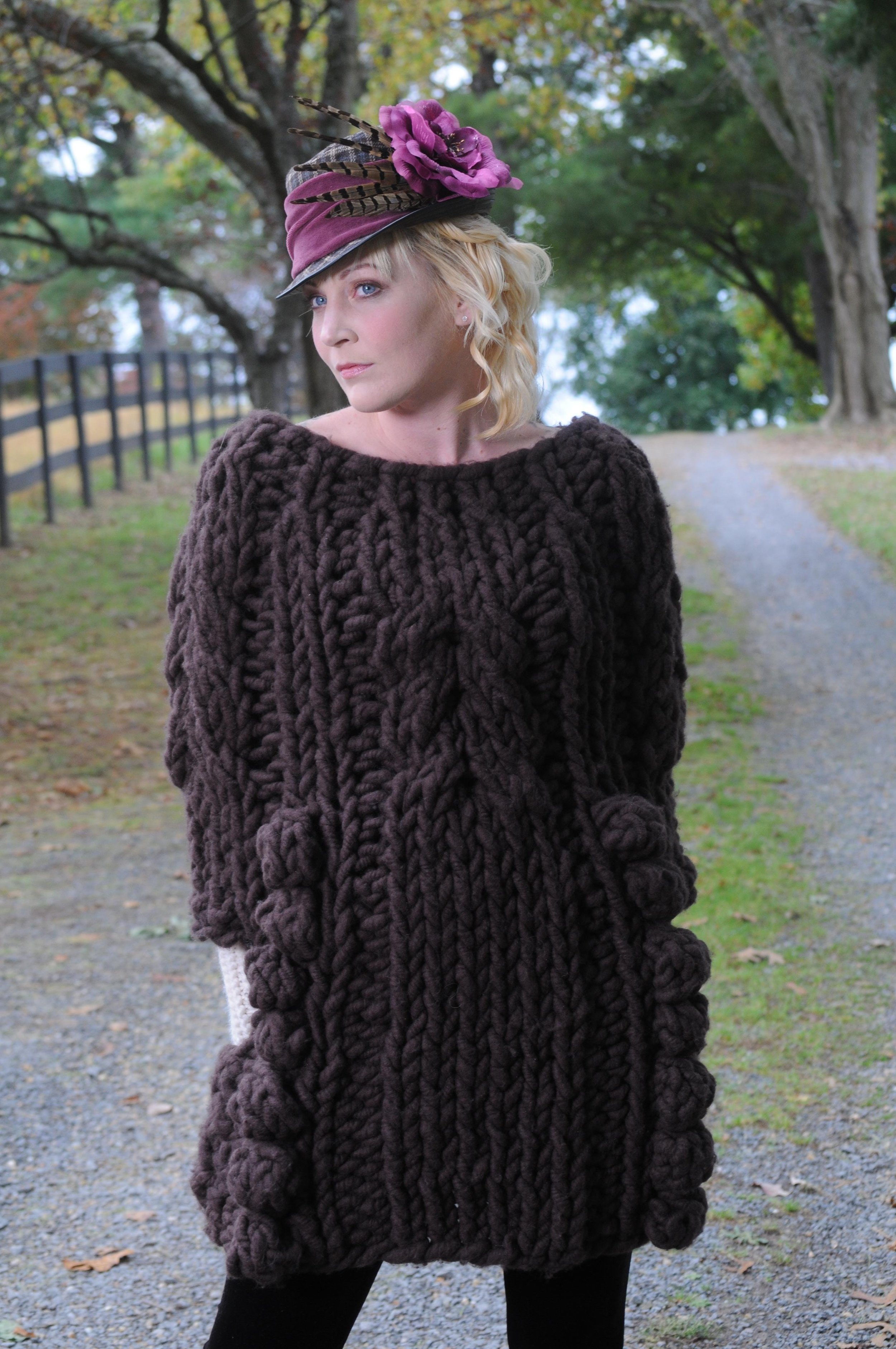Bobble and Twist is a pullover sweater poncho -coat with side pockets.  Designed by Terri Rosenthal   with a collaboration with Becca Smith of The BagSmith     Hard copy pattern, PDF, Kits and finished garment. Seen in Big Bump yarn by The BagSmith.
