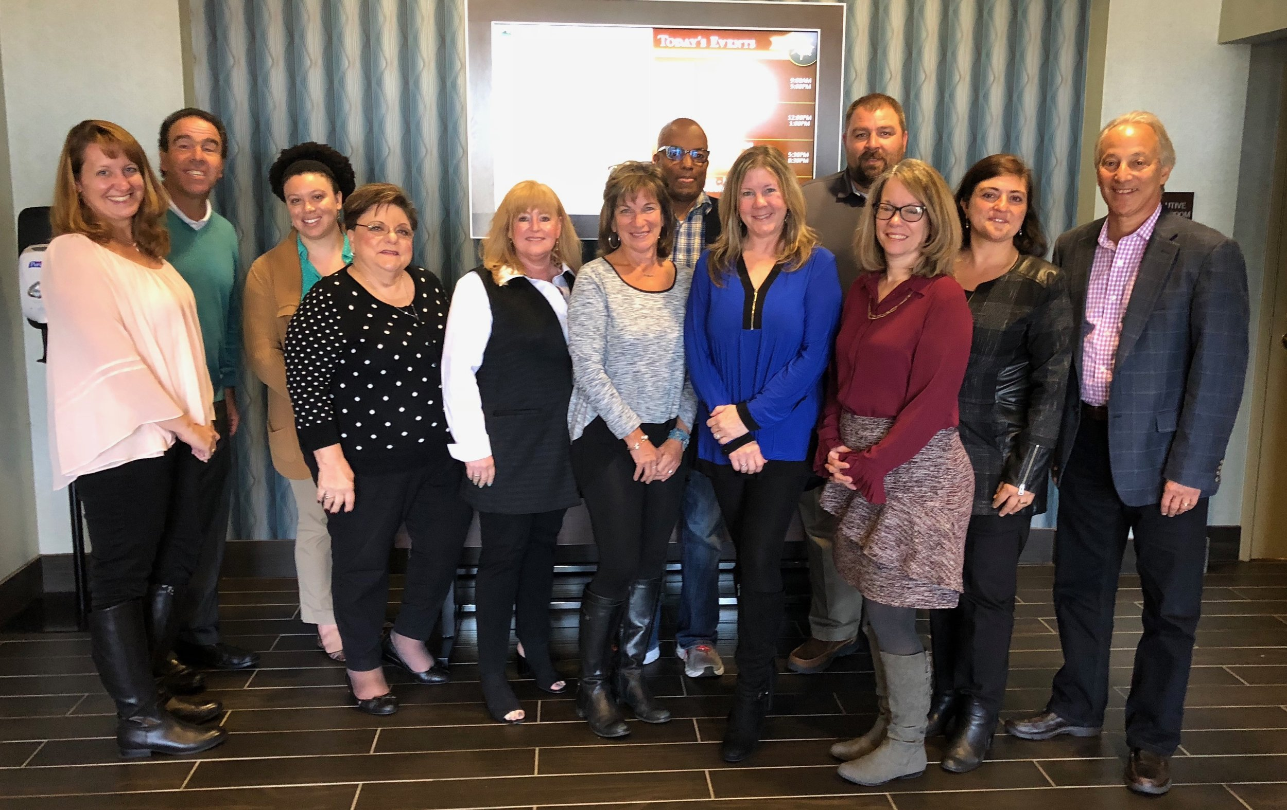 October 2018 Retreat  Pictured: Vera Simmons, Pete Mangione, MySha Allen, Tina Broccolino, Beth Ditman, Susie Davis, Rocky Brown, Michelle Wildman, Wayne Johnson, Christie Lassen, Anita Broccolino, Joe Barbera.