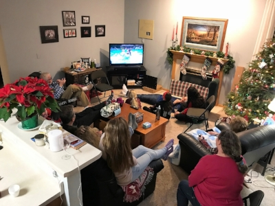 My family sharing memories watching old slideshows and home movies over the holidays