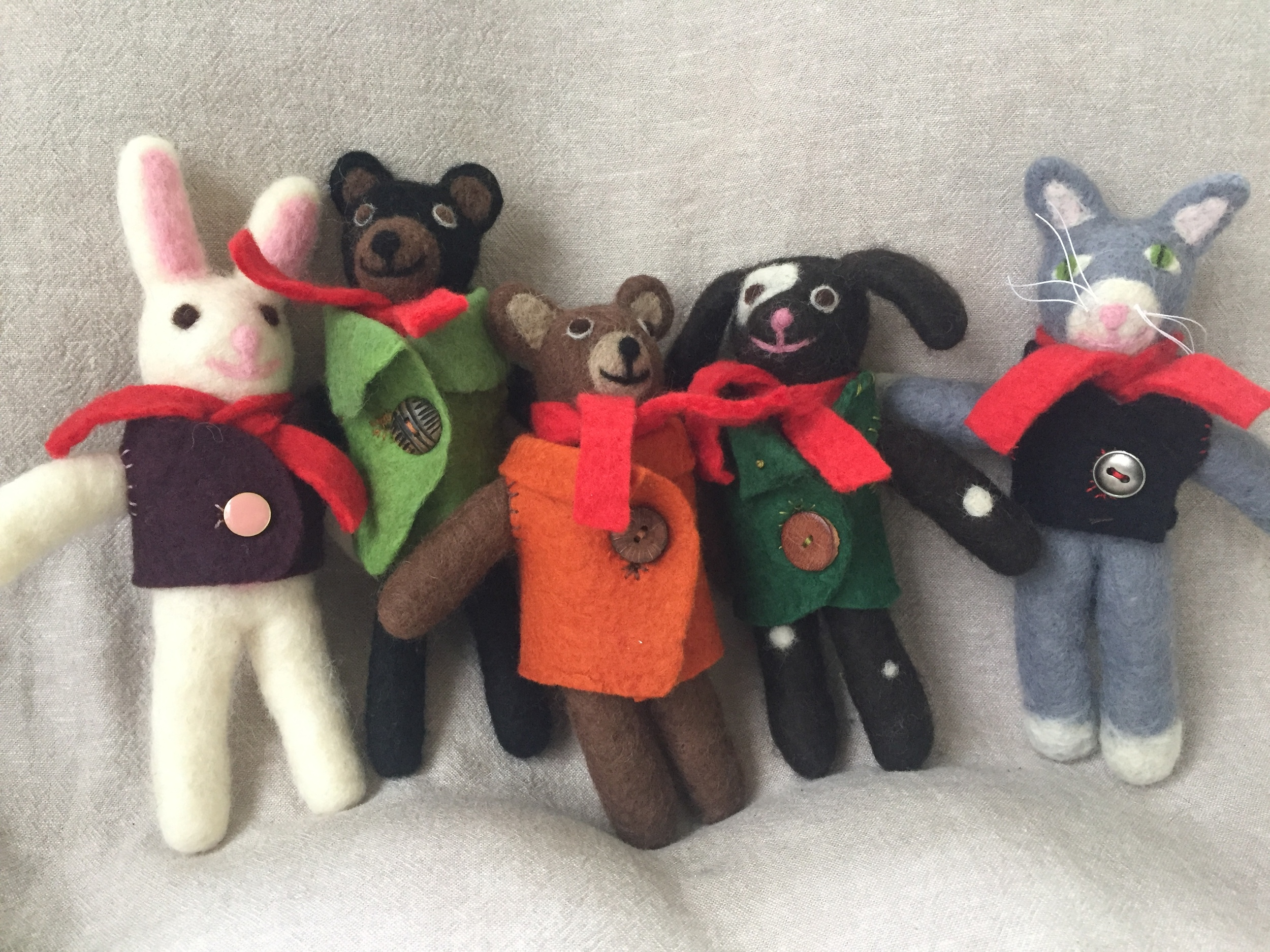 Wet felted, sturdy little friends. About 8 inches tall. May be made with or without jackets.
