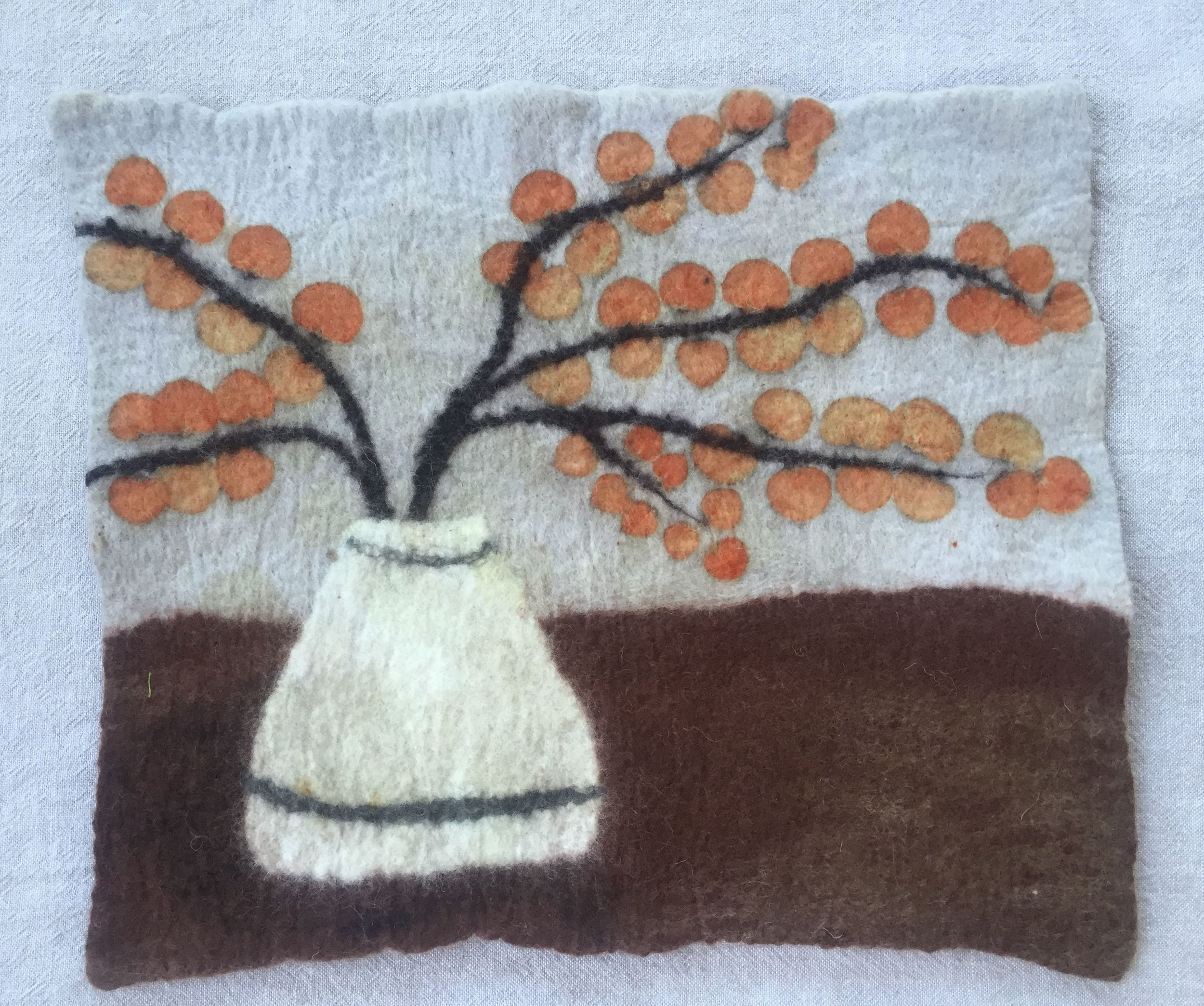 Wet felted wall hanging, eco printed with eucalyptus.