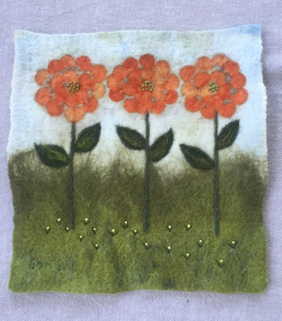 Wet felted, eco printed wall hanging, embellished with embroidery.