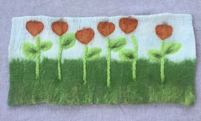 Wet felted, eco printed wall hanging.