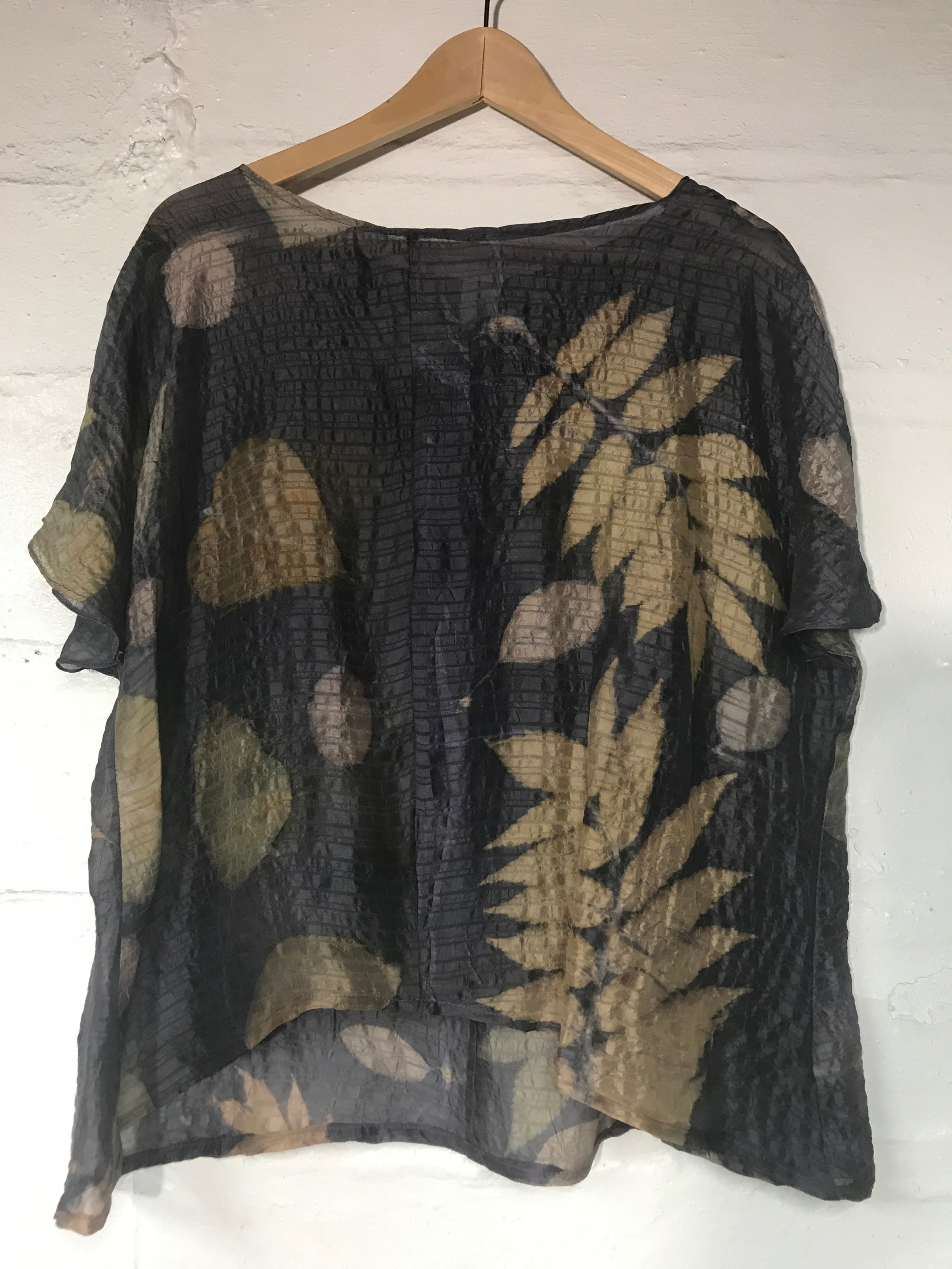 Silk dyed in logwood and printed with smokebush and sumac leaves.