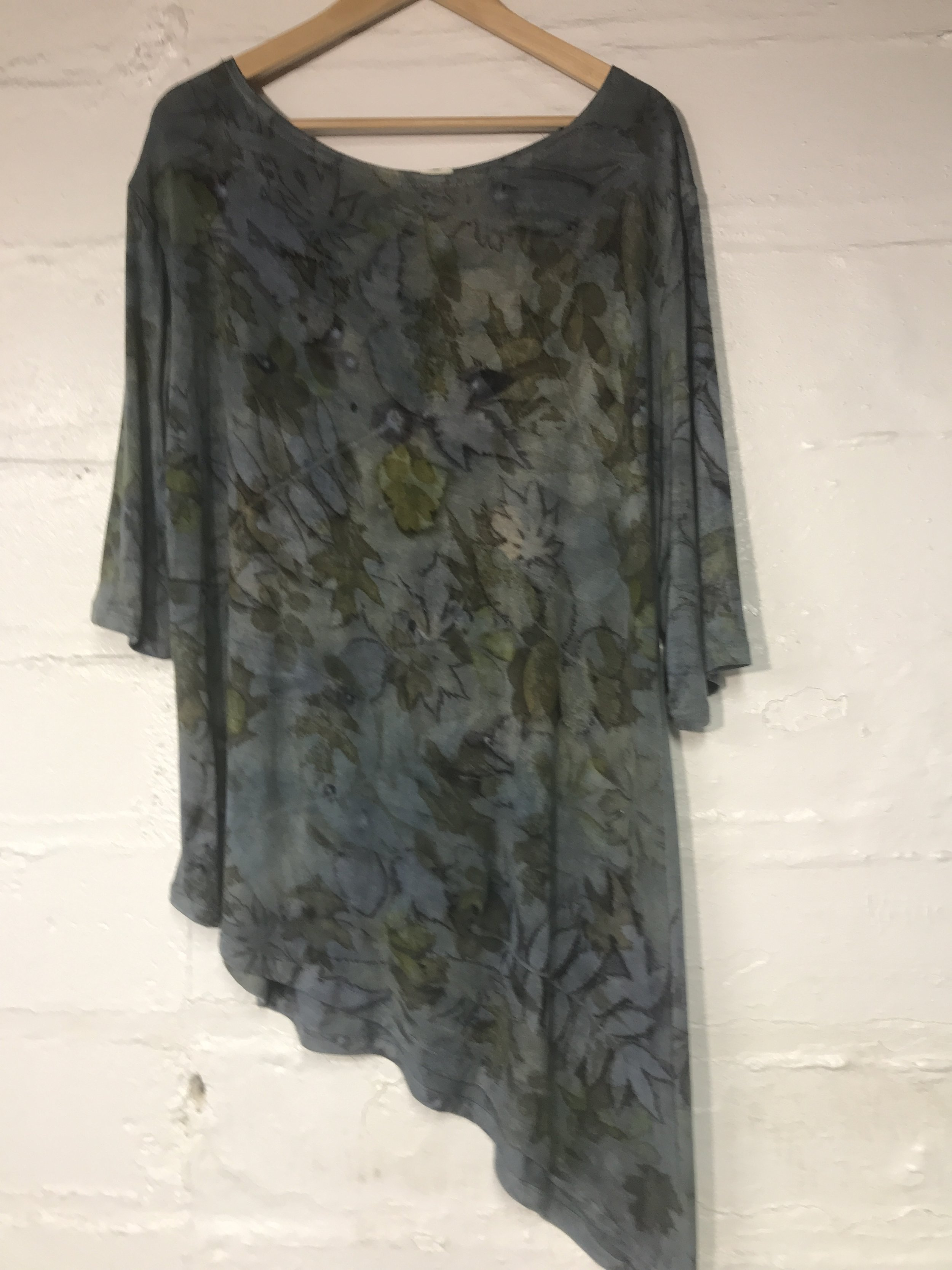 Bamboo jersey died in indigo and printed with various local leaves.