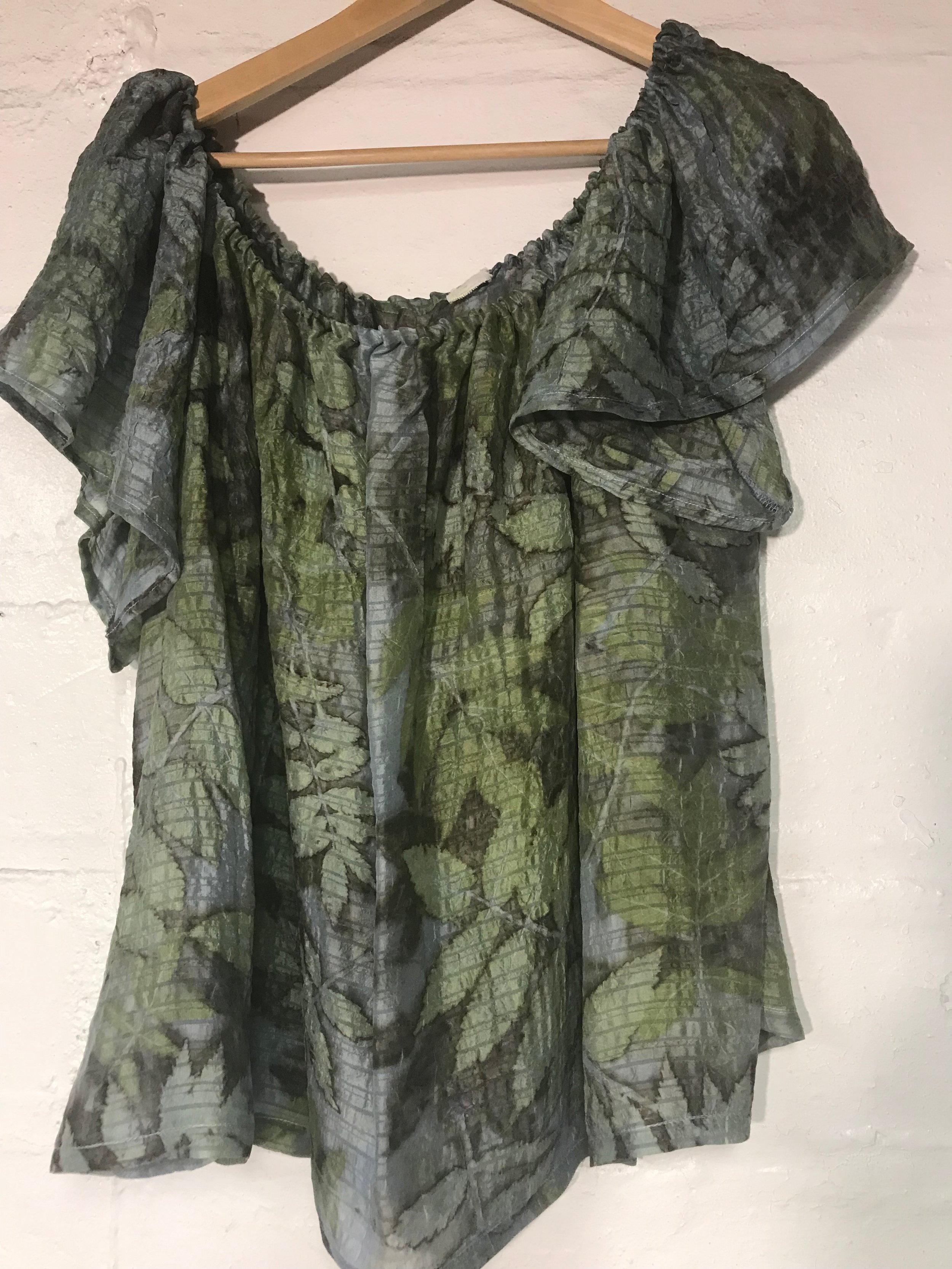Silk dyed in indigo and printed with sumac and false spirea leaves.