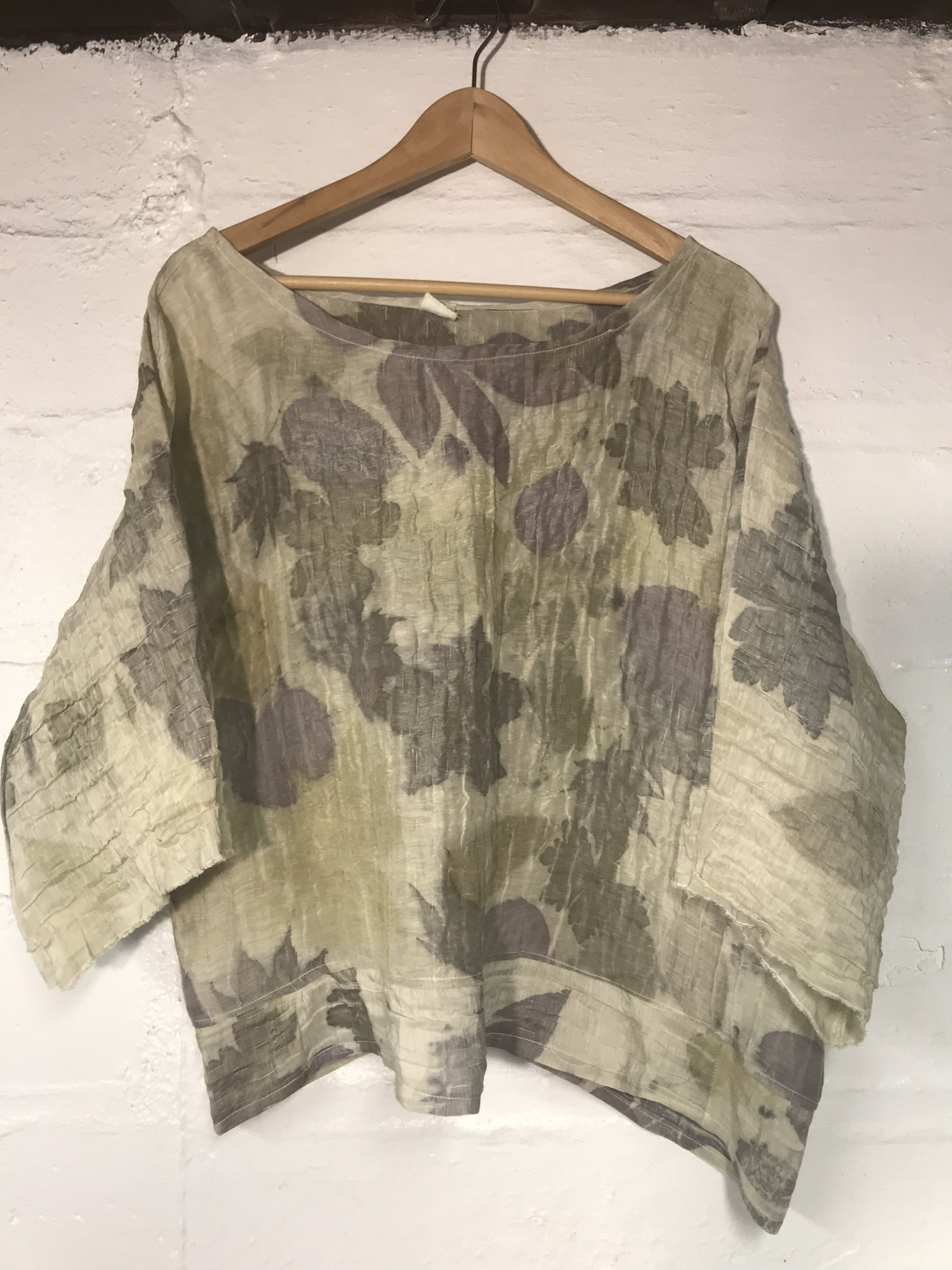 Silk printed with various local leaves.