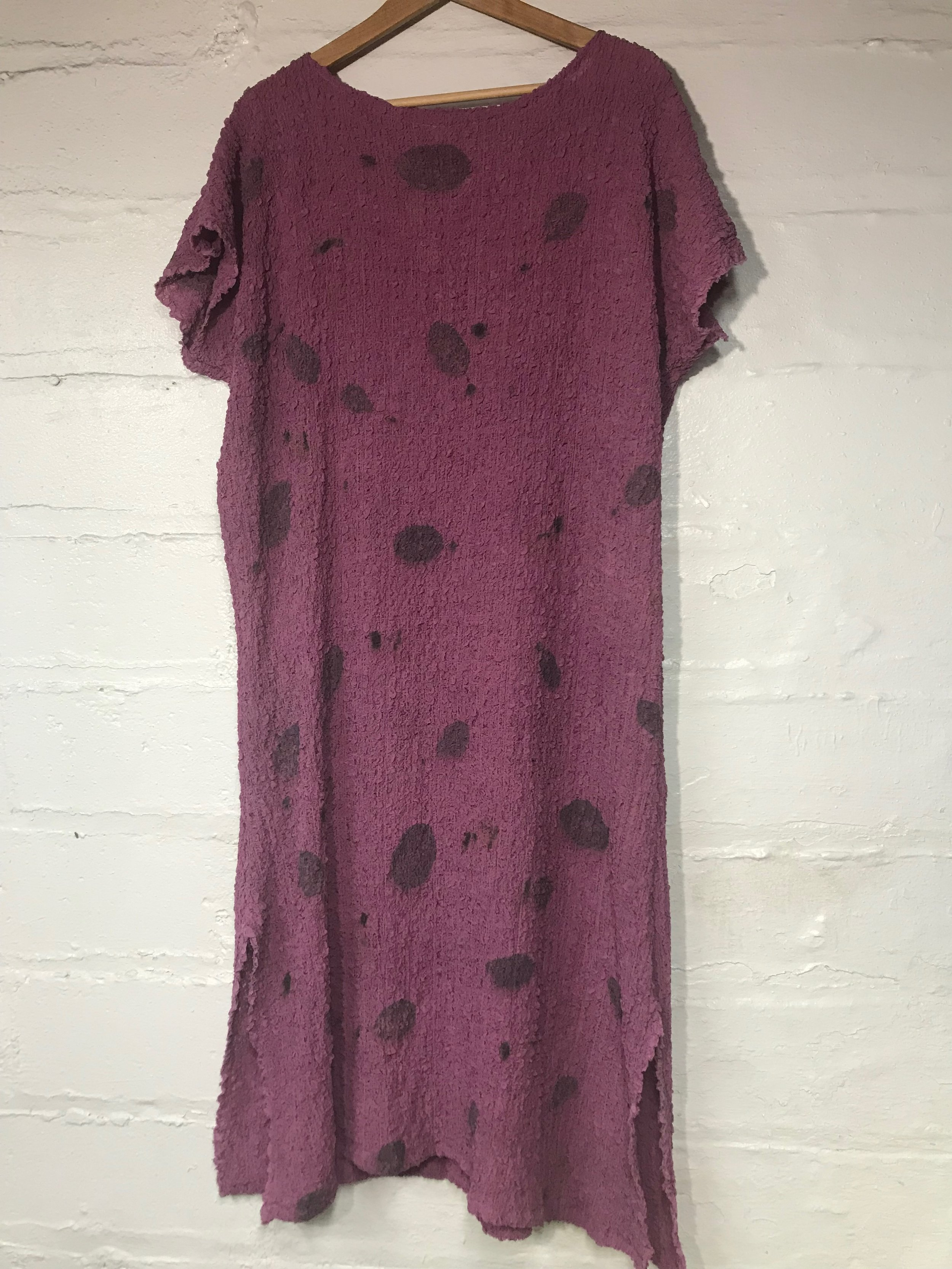 Textured silk dyed in cochineal and printed with smokebush leaves.