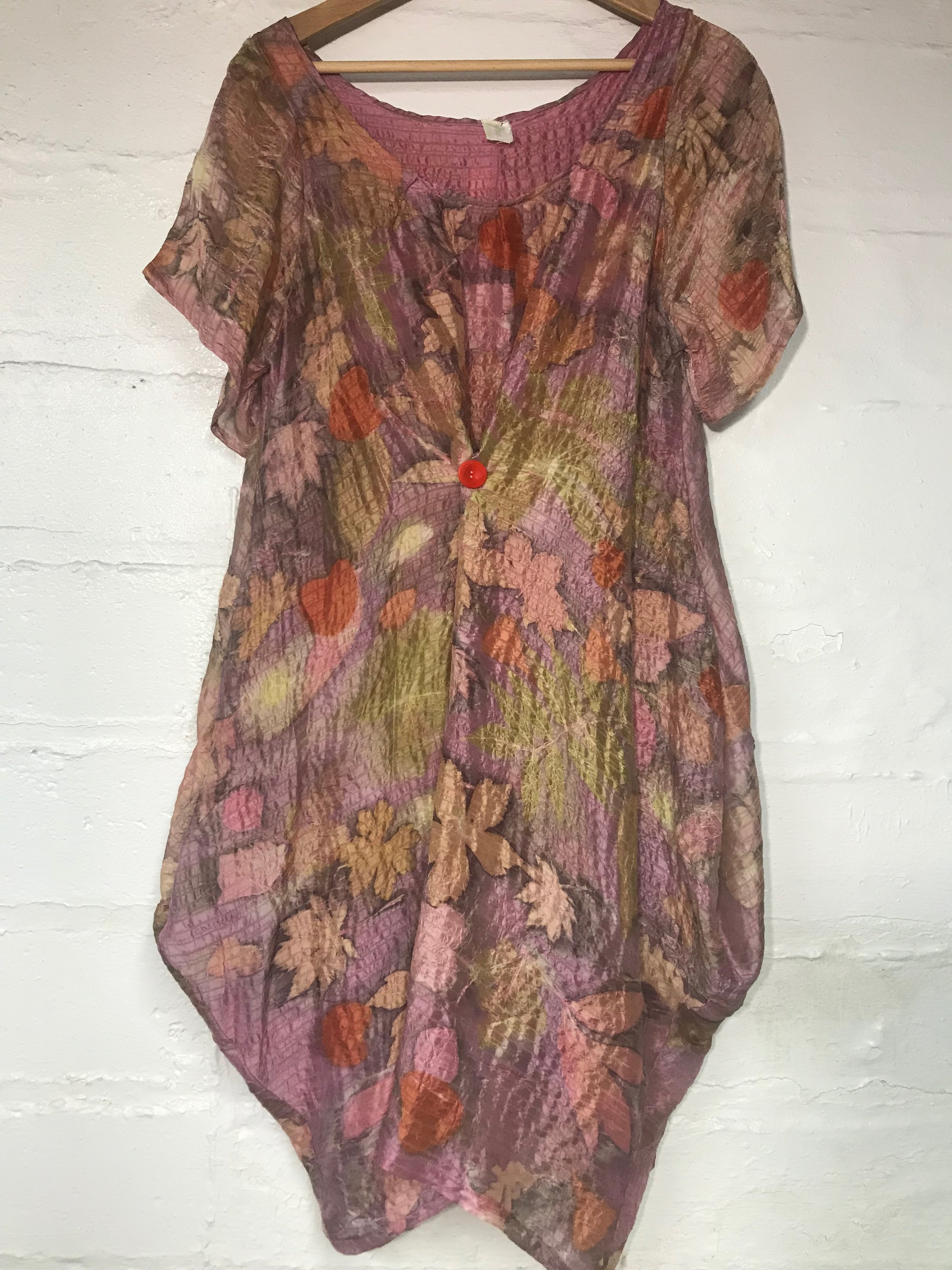 Silk dyed in cochineal and printed with various local leaves.