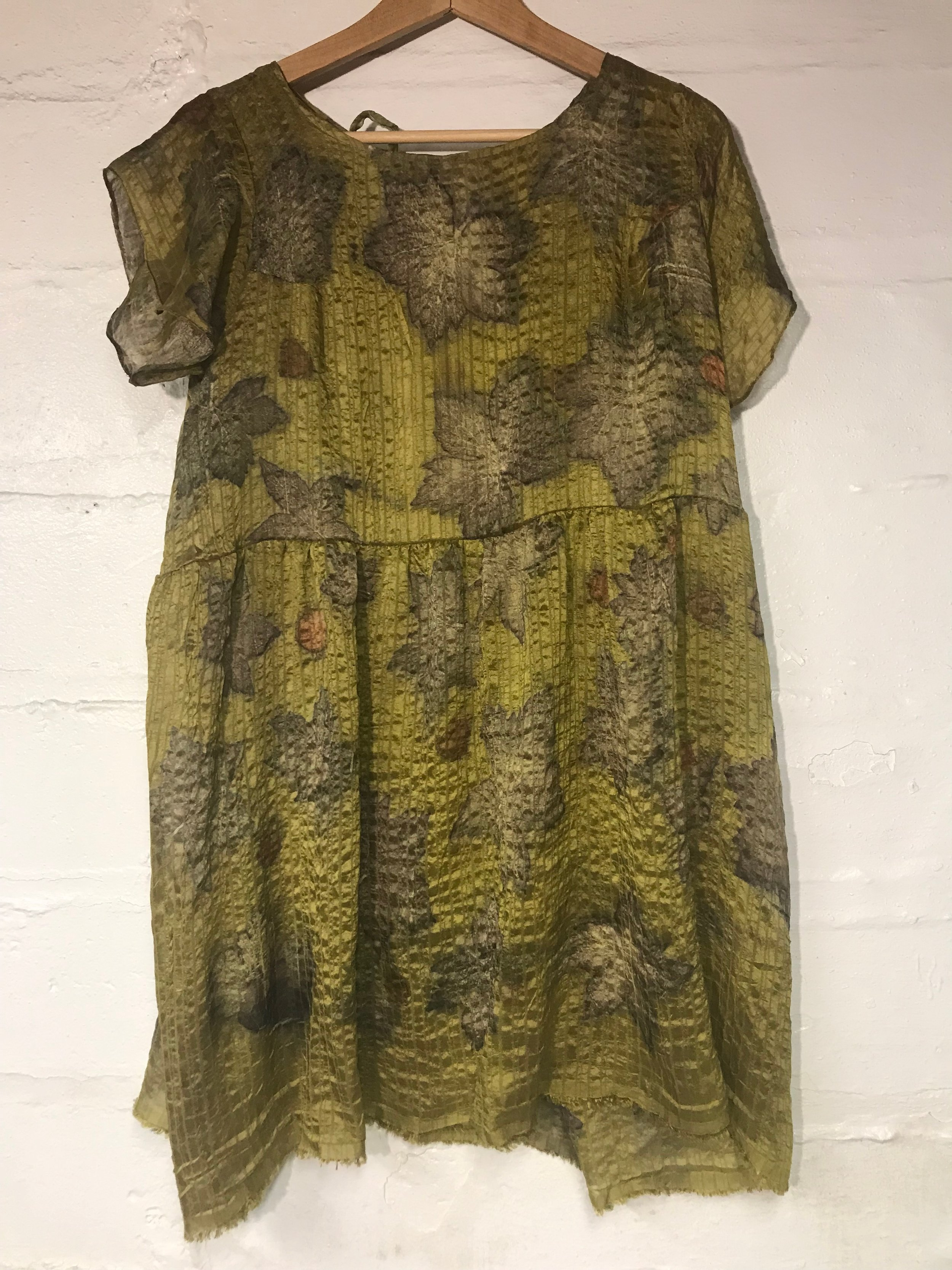 Silk dyed in orange osage and printed with wild geranium leaves.