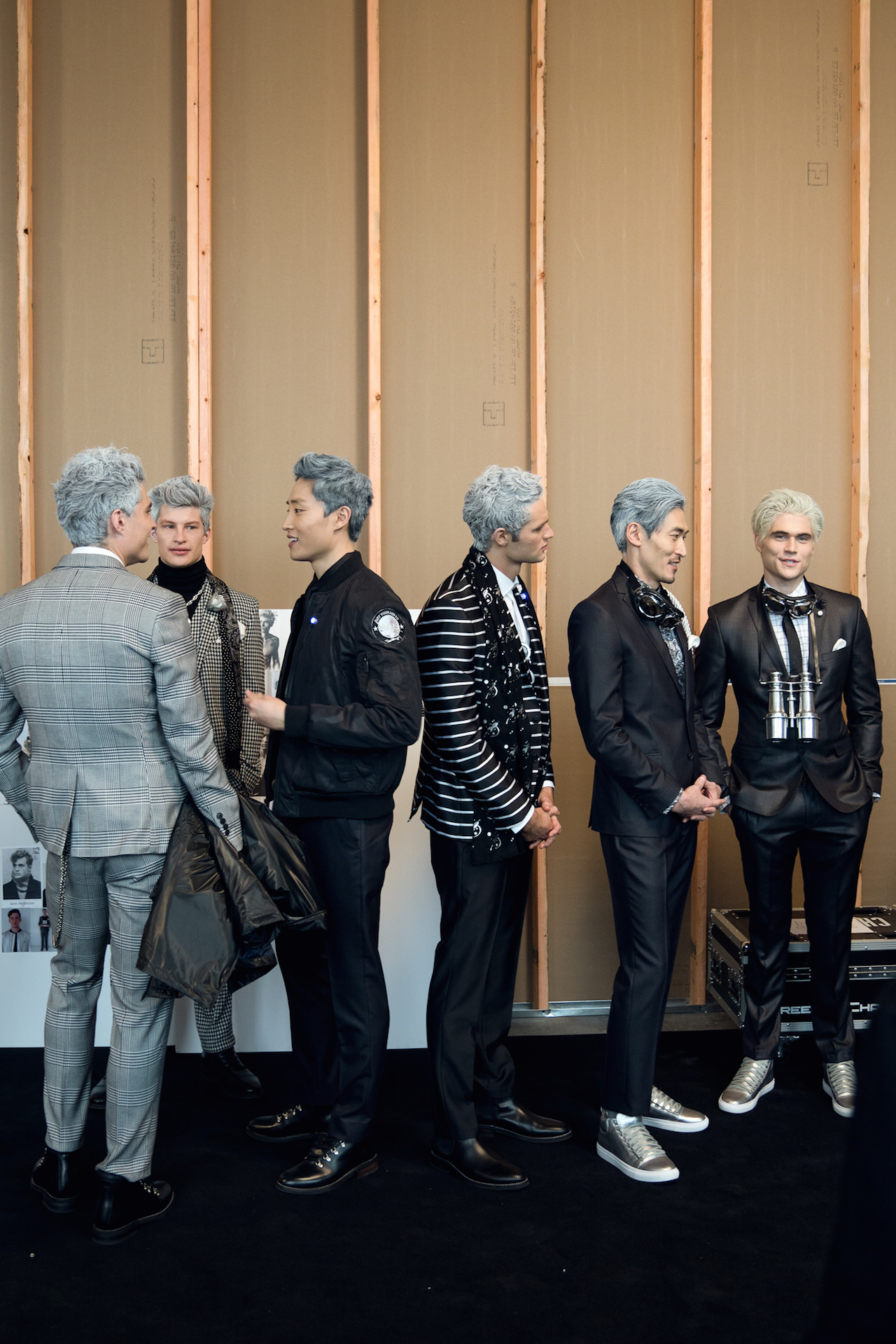 Silver-haired models hanging backstage before walking out onto Nick Graham's space-themed runway. Shot with my Sony A7RII w/ Sony 24-70 2.8 G Master |    ISO 500 | 1/125s | f/2.8