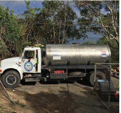 Municipal water trucks delivering water to mountain towns in Lajas