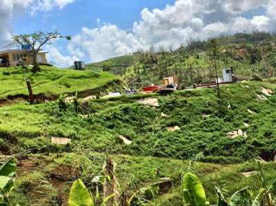 Homes destroyed, bits and pieces of a family's home strewn down the mountainside in Morovis