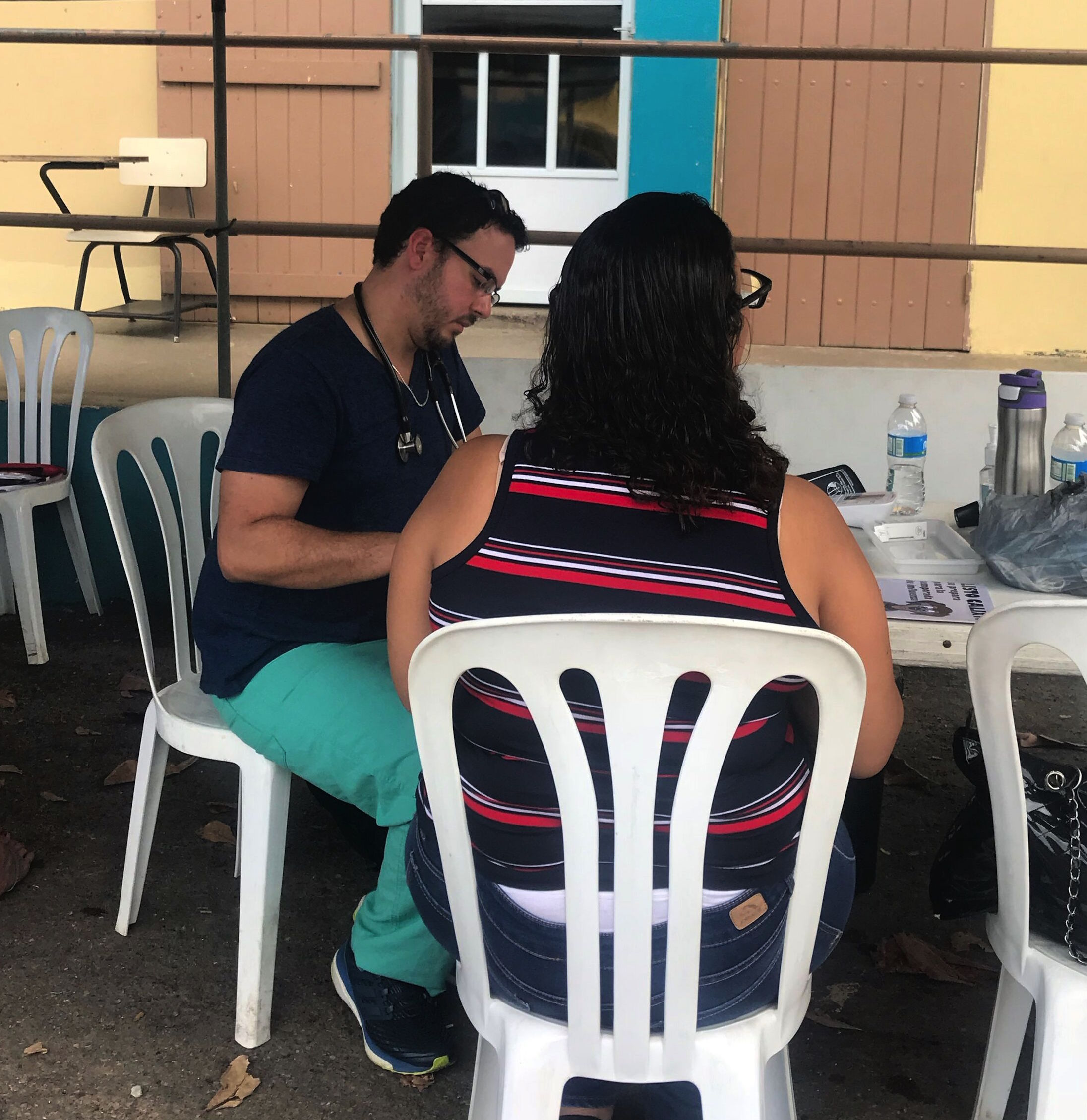 Puerto Rican physician Manuel Betancourt triages patients