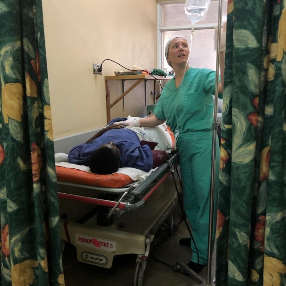 IMR volunteer, Liz Santaniello, FNP, cares for patients post-surgery