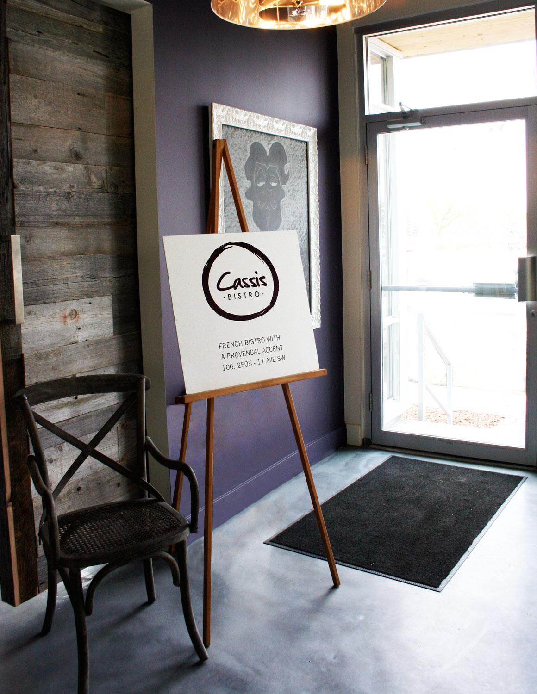 Cassis Bistro entrance easel sign